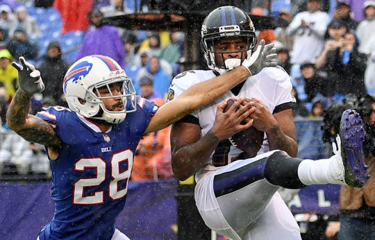 Baltimore Ravens wide receiver Michael Crabtree, right, pulls in a touchdown pass under pressure from Buffalo Bills defensive back Phillip Gaines (28) during the first half of an NFL football game Sunday, Sept. 9, 2018, in Baltimore. (AP Photo/Nick Wass)