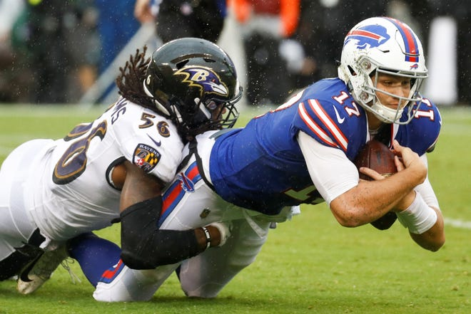 Buffalo Bills quarterback Josh Allen (17) is healed to the turf by Baltimore Ravens linebacker Tim Williams (56) during the second half of an NFL football game between the Baltimore Ravens and the Buffalo Bills, Sunday, Sept. 9, 2018, in Baltimore. (AP Photo/Patrick Semansky)