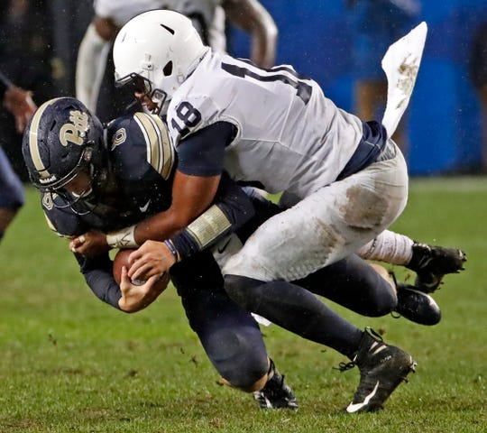 Pittsburgh quarterback Kenny Pickett (8) is sacked by Penn State defensive end Shaka Toney (18) during the second half of an NCAA college football game in Pittsburgh, Saturday, Sept. 8, 2018. Penn State won 51-6.