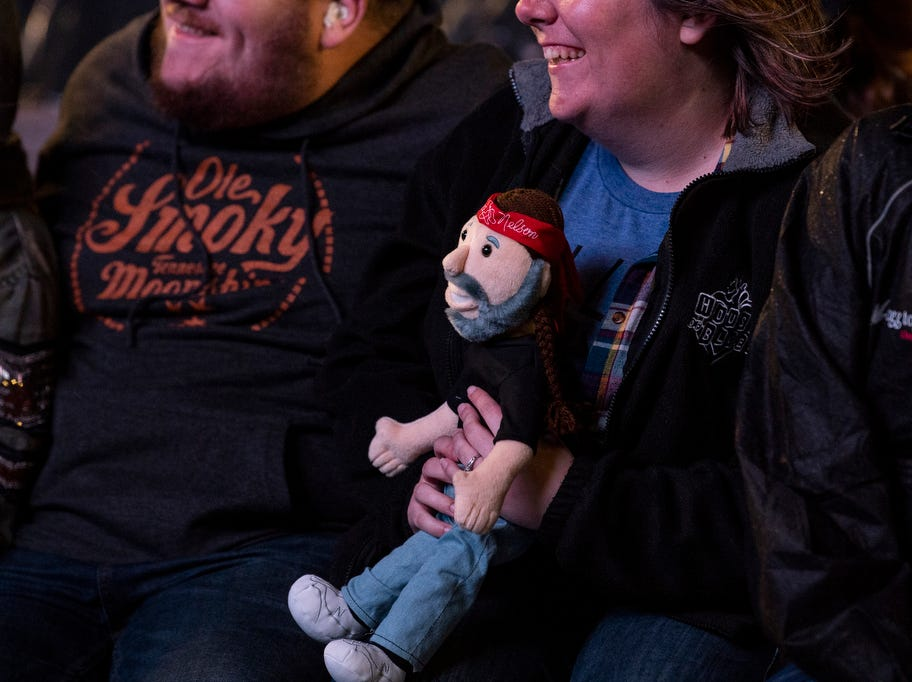 Fans at the Outlaw Country Music Festival hold a Willie Nelson doll, Saturday, September 8, 2018. The Outlaw Country Music Festival also had performers Willie Nelson & Family, Tedeschi Trucks Band, Sturgill Simpson, Lukas Nelson and Promise of the Real and Particle Kid.