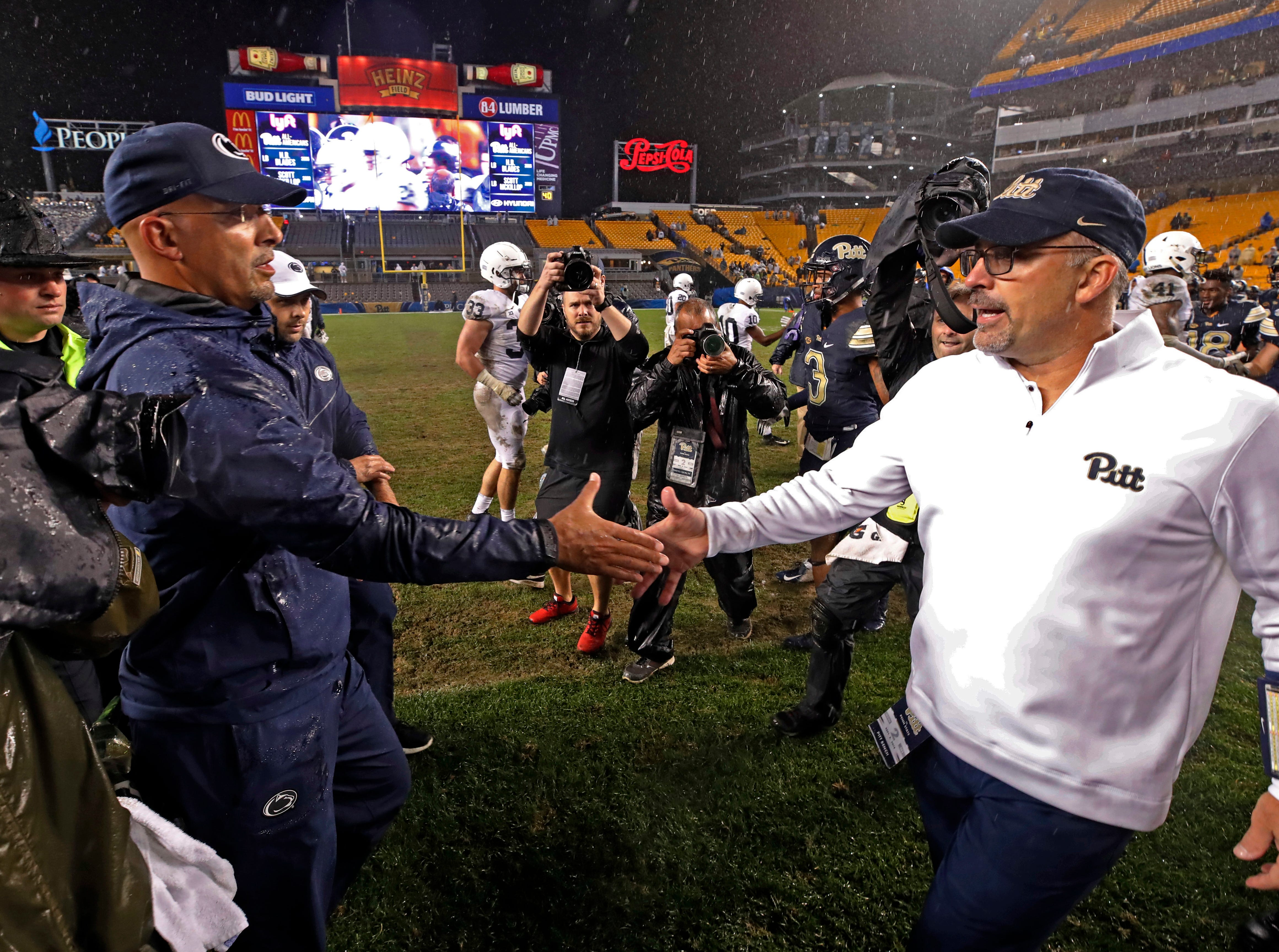 Penn State head coach James Franklin, left, shakes hands with Pittsburgh head coach Pat Narduzzi following an NCAA college football game in Pittsburgh, Saturday, Sept. 8, 2018. Penn State won 51-6.