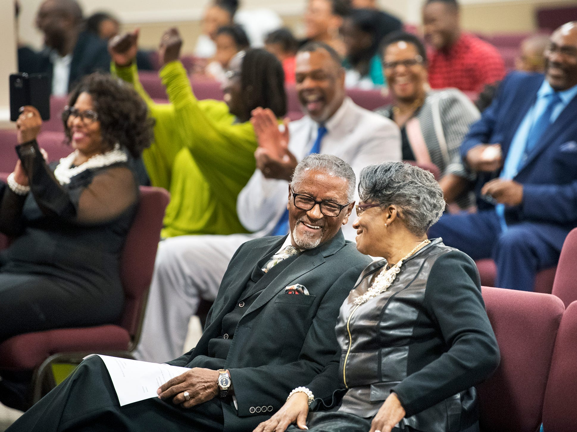 Bishop Carl H. Scott, left, and his wife Diane exchange a glance during a Bishop Carl H. Scott Street Naming Ceremony at Bible Tabernacle Church. A section of South Pine Street was renamed to honor Scott.