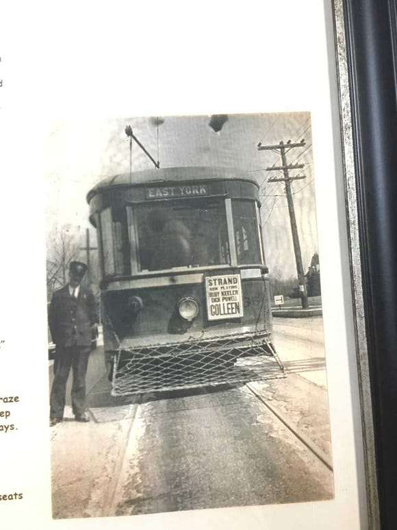 Charles Klunk is seeen in front of the York streetcar that he operated.