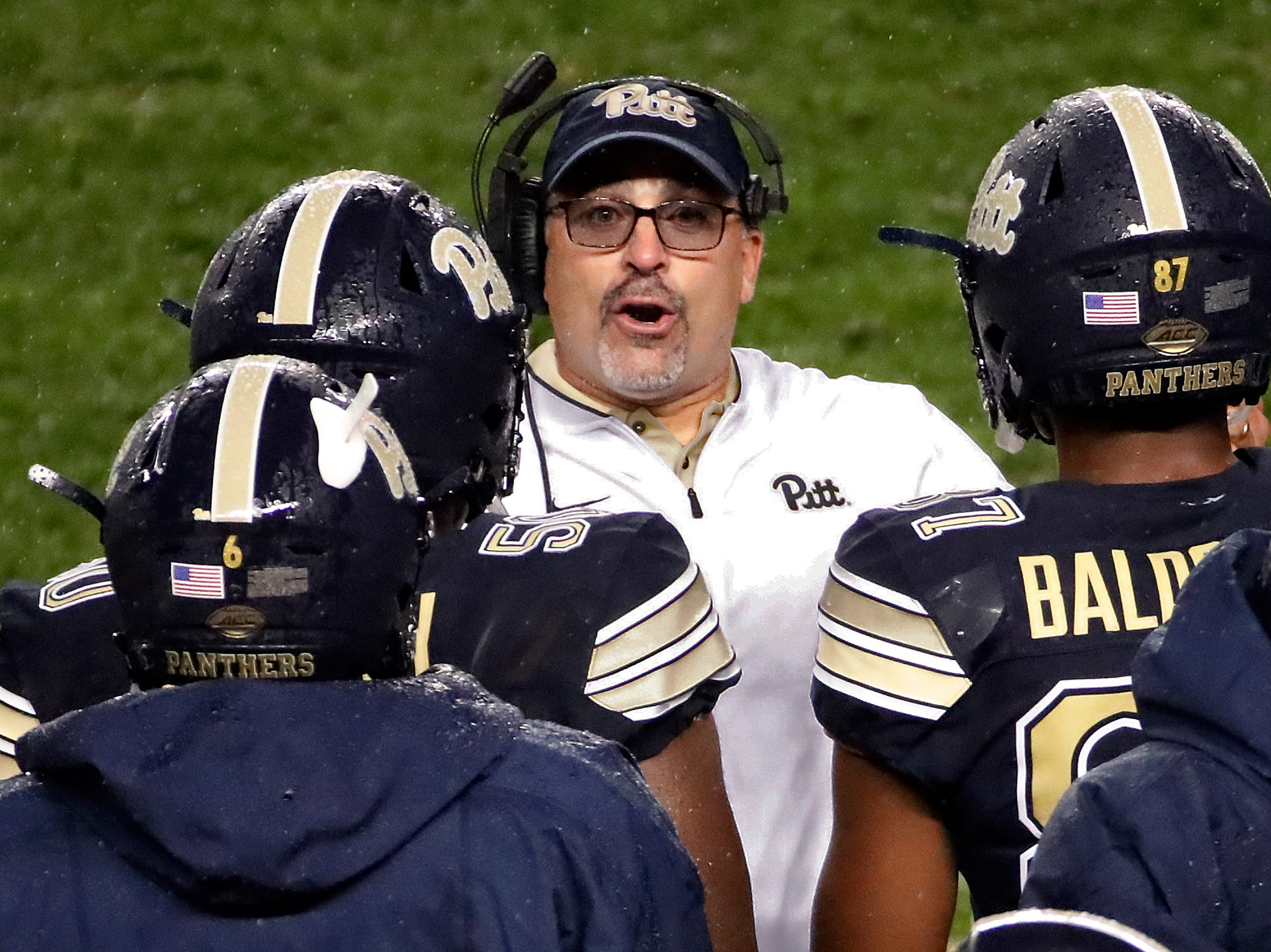 Pittsburgh head coach Pat Narduzzi , center, talks with his defense during the first half of an NCAA college football game against Penn State in Pittsburgh, Saturday, Sept. 8, 2018. Penn State won 51-6.