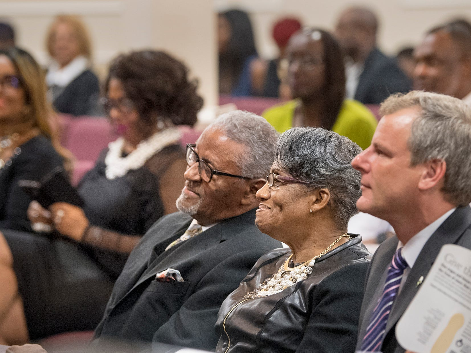 From the left, Bishop Carl H. Scott, his wife Diane and York Mayor Michael Helfrich listen to the speakers during the street Naming Ceremony at Bible Tabernacle Church.