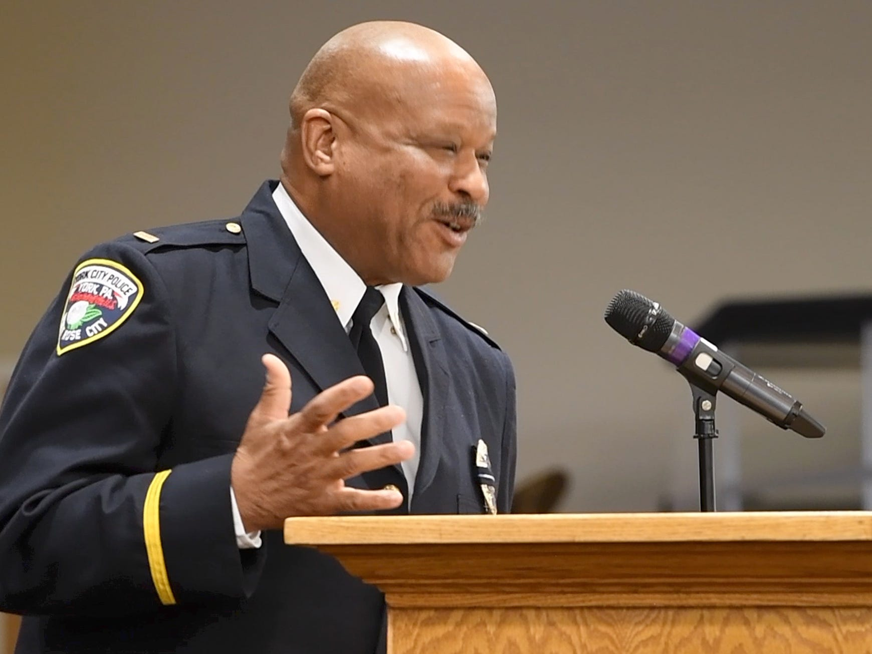 Lt. Gene Fells, of the York City Police Department, honors Bishop Scott during the Bishop Carl H. Scott Street Naming Ceremony at Bible Tabernacle Church.