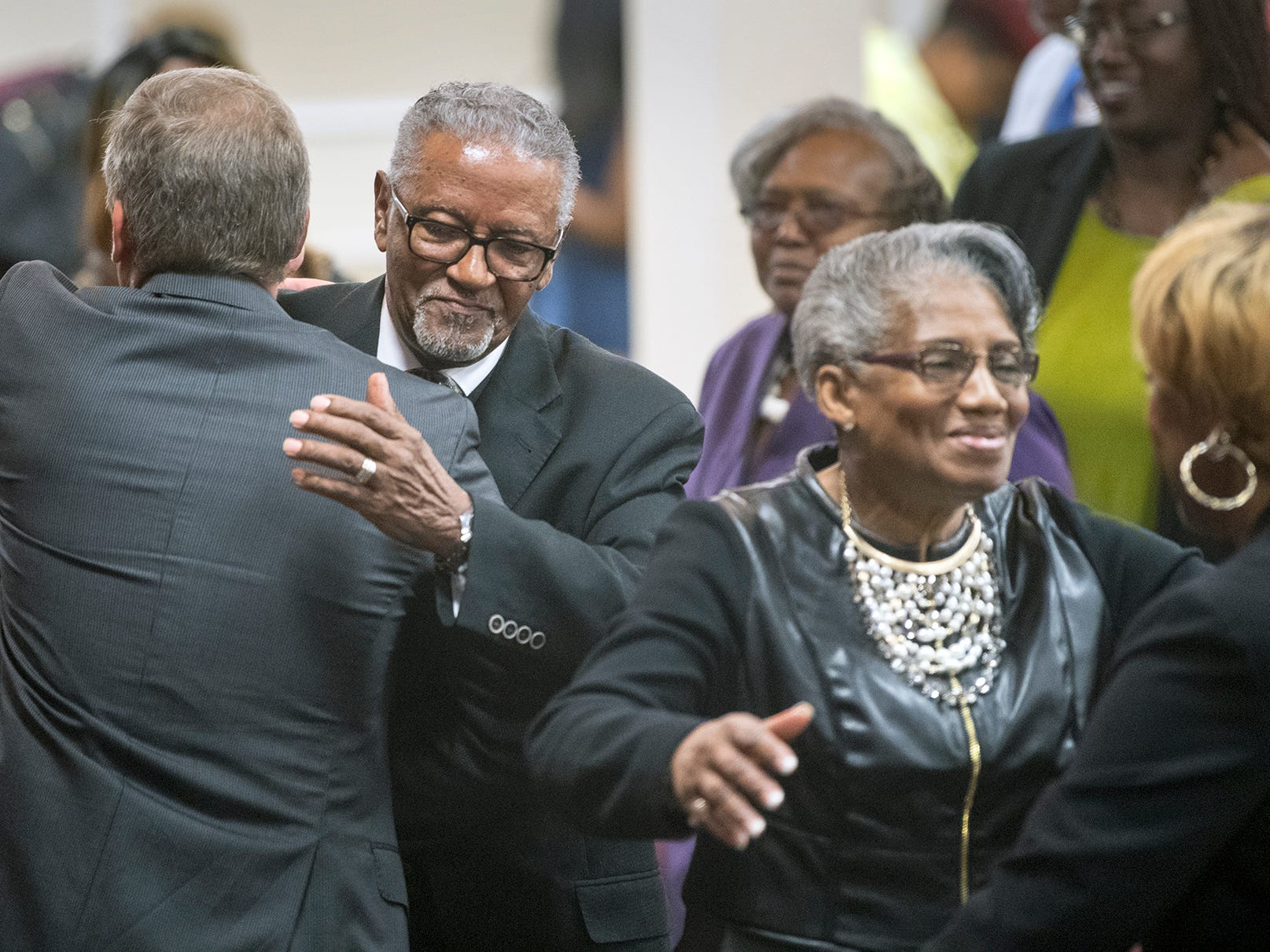 From the left, York Mayor Michael Helfrich hugs Bishop Carl H. Scot, while his wife Diane hugs State Rep. Carol Hill Evans, during the Bishop Carl H. Scott Street Naming Ceremony at Bible Tabernacle Church.