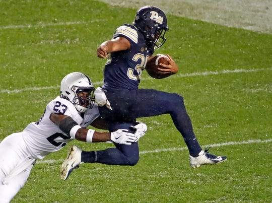 Pittsburgh running back Qadree Ollison (30) leaps out of the grasp of Penn State safety Ayron Monroe (23) and into the end zone for a touchdown during the first half of an NCAA college football game in Pittsburgh, Saturday, Sept. 8, 2018.