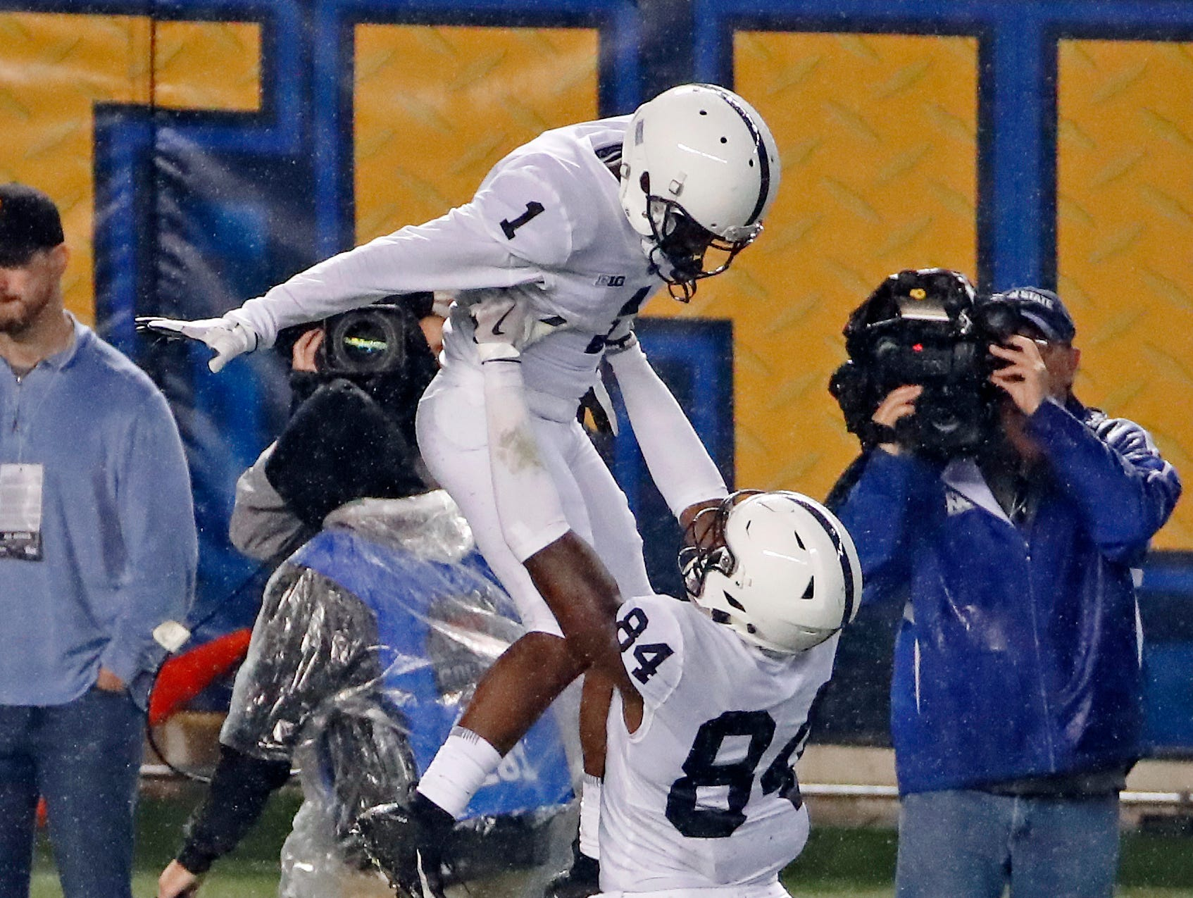 Penn State wide receiver KJ Hamler (1) is hoisted by Juwan Johnson (84) after scoring a touchdown during the first half of an NCAA college football game against Pittsburgh in Pittsburgh, Saturday, Sept. 8, 2018.