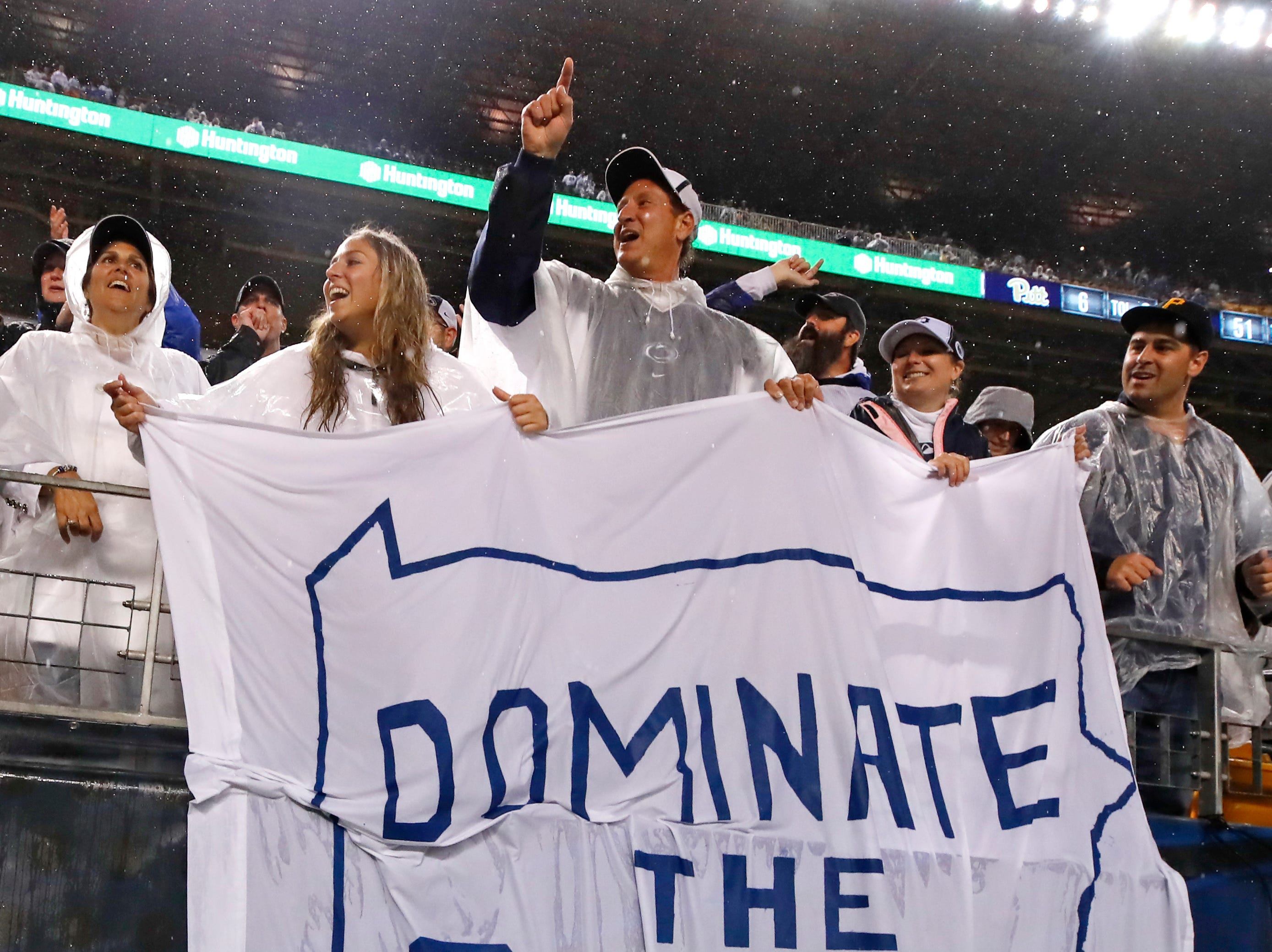 Penn State fans celebrate during the second half of an NCAA college football game between Pittsburgh and Penn State in Pittsburgh, Saturday, Sept. 8, 2018. Penn State won 51-6.