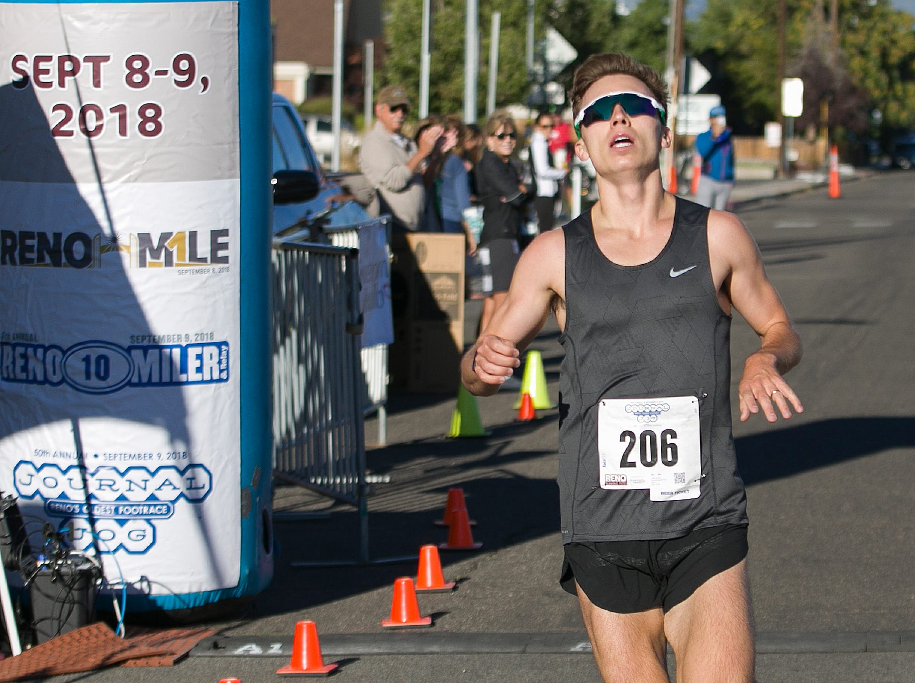Tyler Sickler crosses the finish line to win the 50th Annual Journal Jog in Reno, Nevada on Sunday, September 9, 2018.