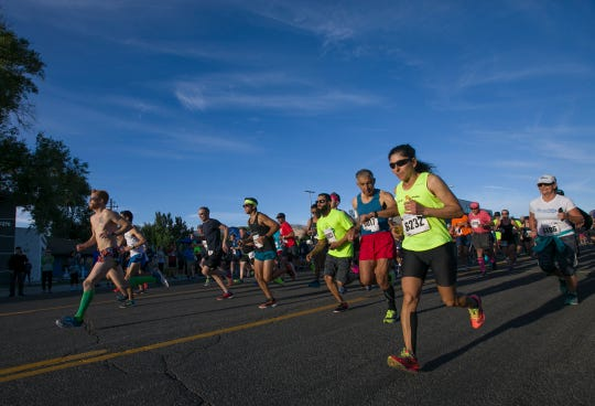 Runners start the Reno 10-Miler race during the 50th Annual Journal Jog in Reno on Sunday. Ramona Sanchez  at right, bib No. 6232, was the top women finisher in the 10-mile race