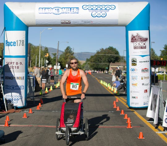 Dave Zaski, pushing daughter Makaylin, wins the stroller portion of the 50th Annual Journal Jog in Reno on Sunday.
