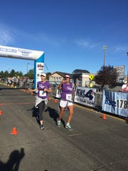 Shelly Capurro and Devin Borden finish the Journal Jog on Sunday morning in Southwest Reno.