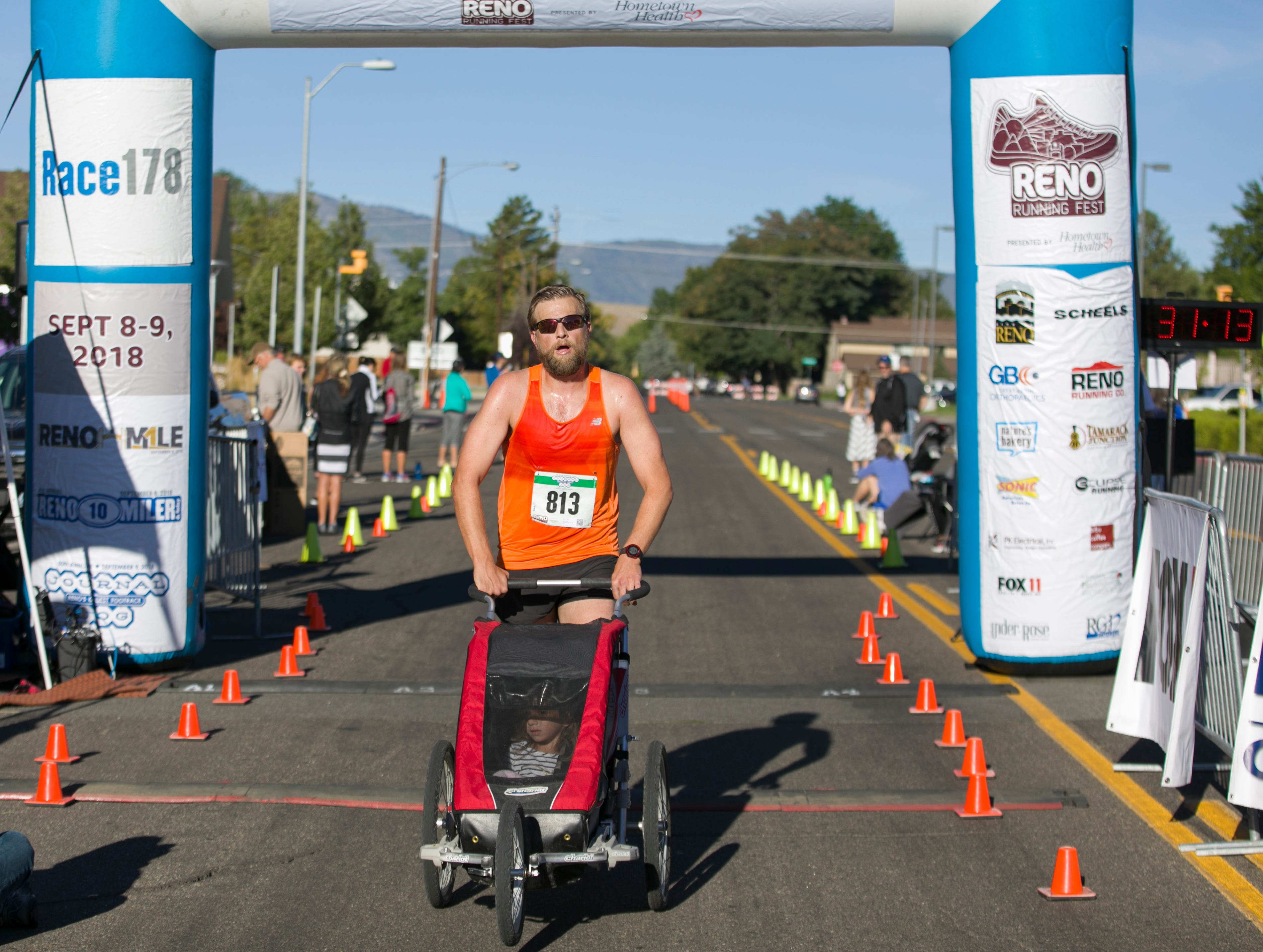 Dave Zaski, pushing daughter Makaylin, wins the stroller portion of the 50th Annual Journal Jog in Reno, Nevada on Sunday, September 9, 2018.