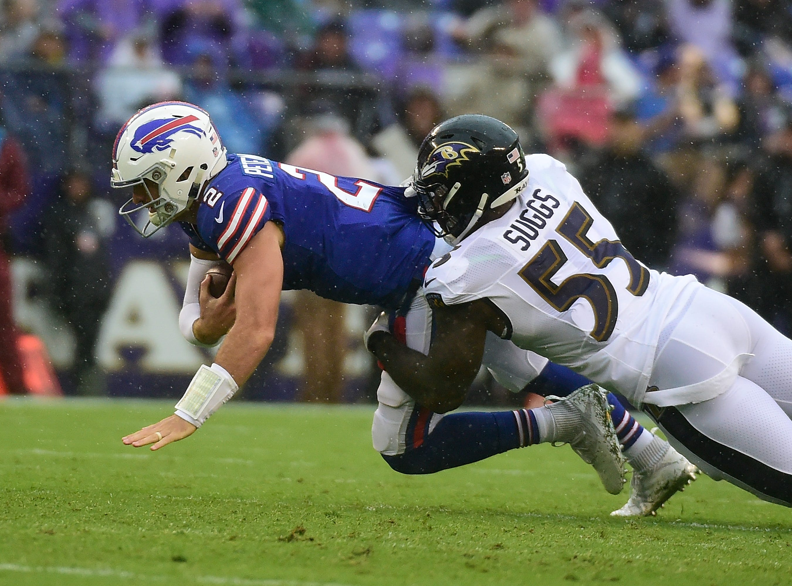 Baltimore Ravens linebacker Terrell Suggs (55) sacks Buffalo Bills quarterback Nathan Peterman (2) during the second quarter at M&T Bank Stadium. Mandatory Credit: Tommy Gilligan-USA TODAY Sports