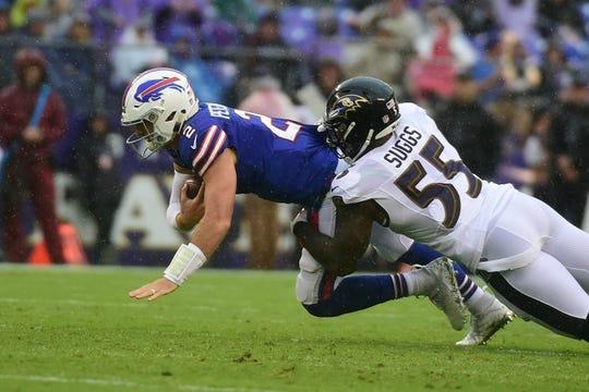 Baltimore Ravens linebacker Terrell Suggs (55) sacks Buffalo Bills quarterback Nathan Peterman (2) during the second quarter at M&T Bank Stadium. Mandatory Credit: Tommy Gilligan-USA TODAY Sports