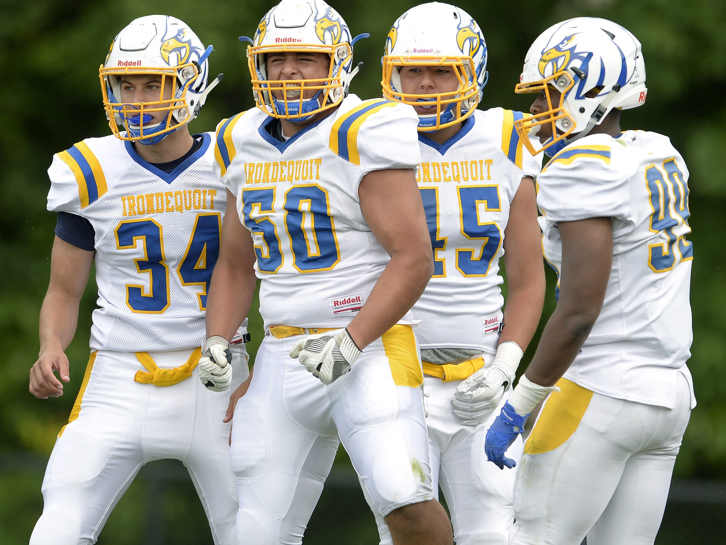 Irondequoit's Nick Serce (50) celebrates his sack with teammates during a regular season game played at Greece Athena High School, Saturday, Sept. 8, 2018. Irondequoit beat Greece Athena 42-7.