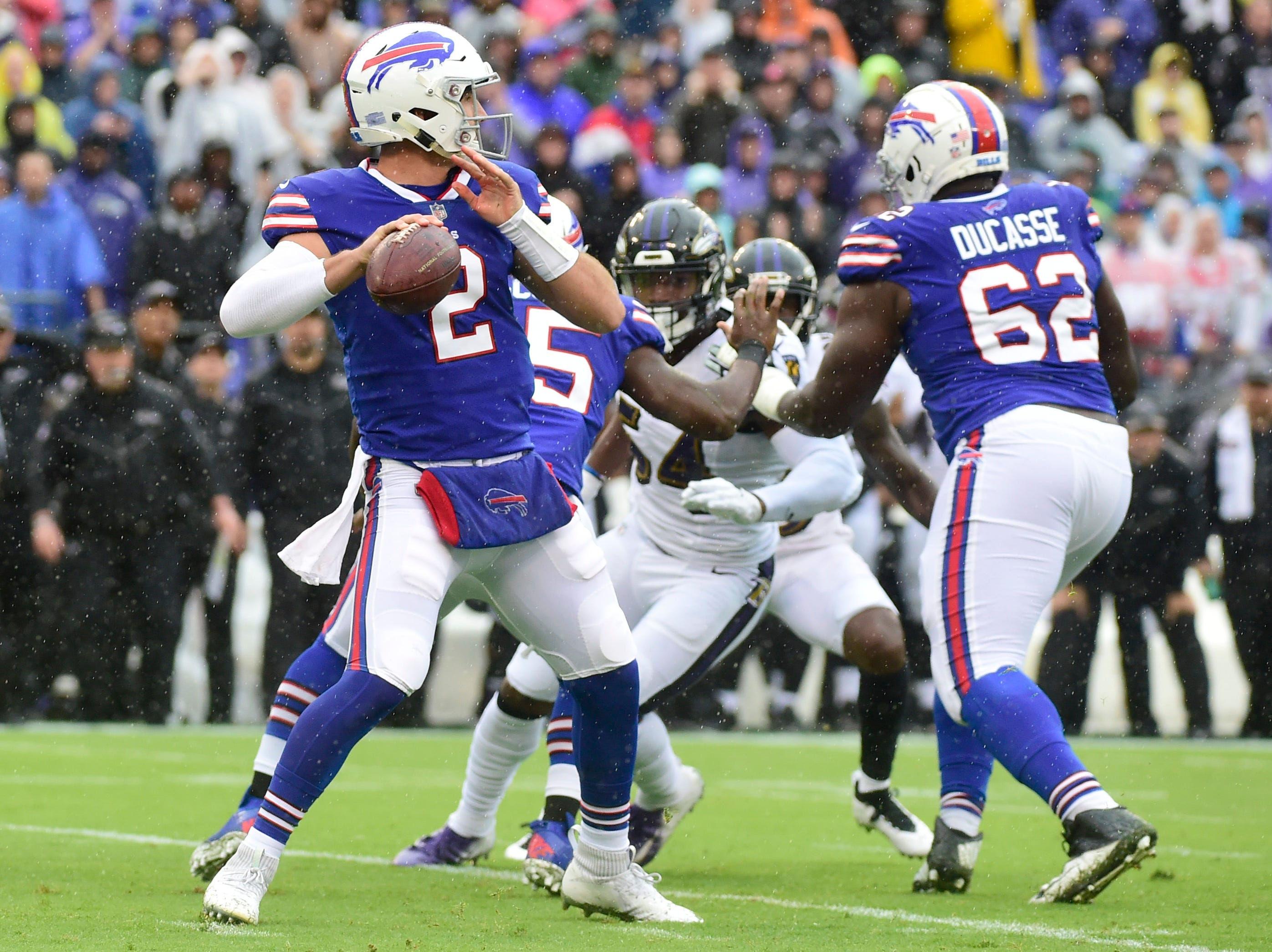 Buffalo Bills quarterback Nathan Peterman (2) drops back to pass during the first quarter against the Baltimore Ravens at M&T Bank Stadium.