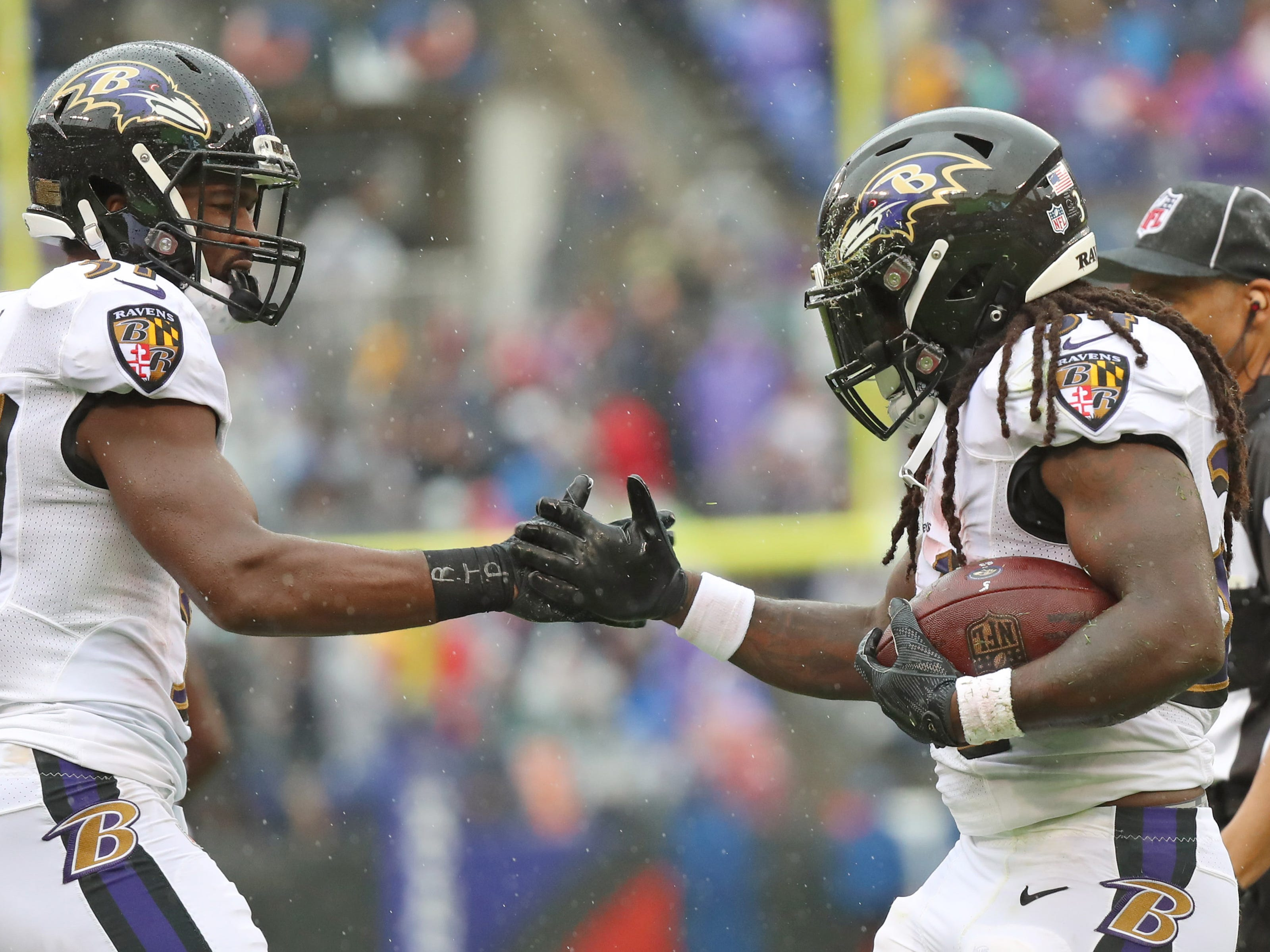 Baltimore Ravens running back Alex Collins (34) is congratulated by Javorius Allen (37) after running for a first quarter touchdown against the Buffalo Bills at M&T Bank Stadium. Mandatory