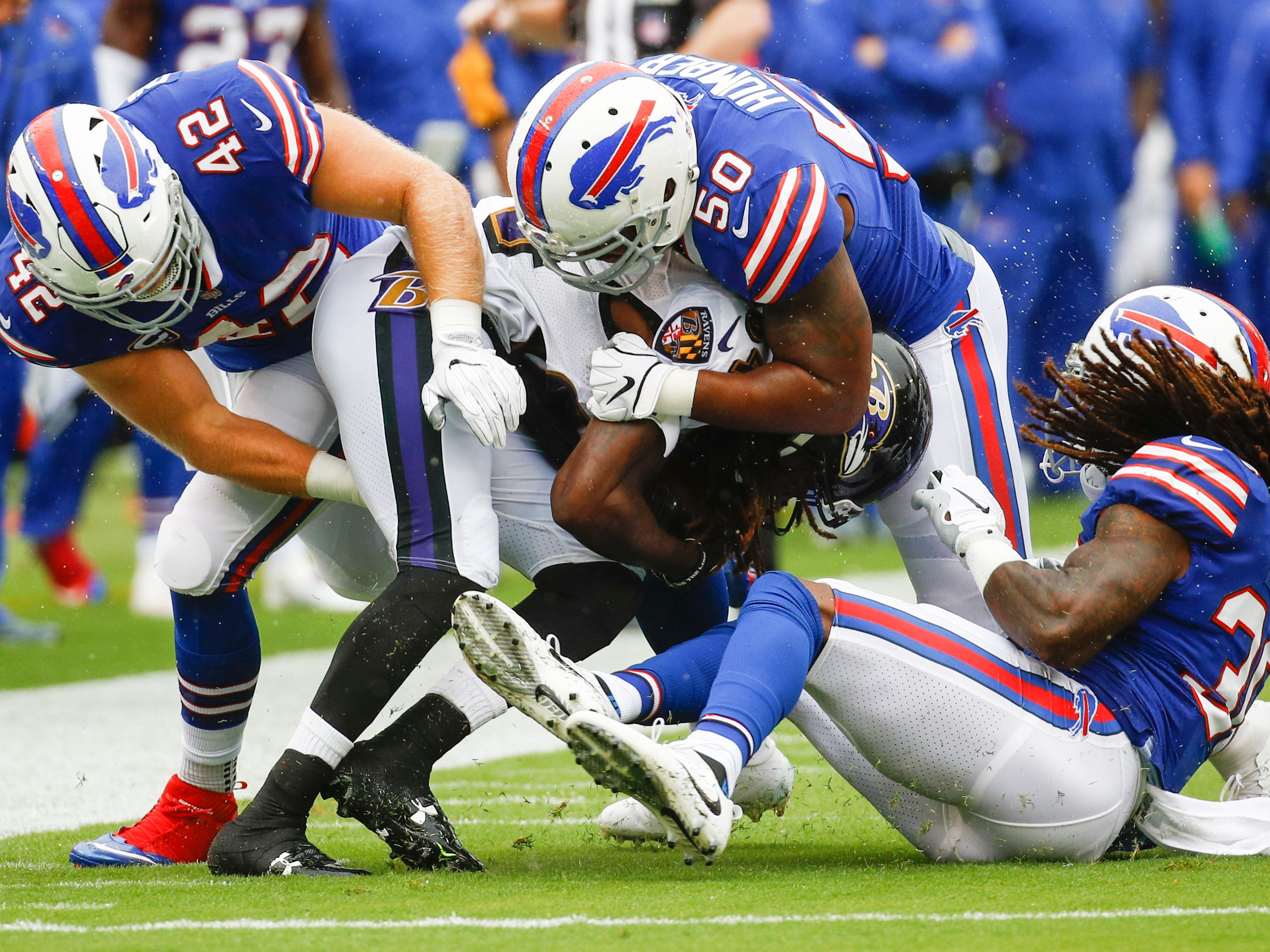Baltimore Ravens wide receiver Janarion Grant (84) is stopped by Buffalo Bills running back Patrick DiMarco (42), linebacker Ramon Humber (50) and cornerback Lafayette Pitts (30) during the first half of an NFL football game between the Baltimore Ravens and the Buffalo Bills, Sunday, Sept. 9, 2018 in Baltimore.