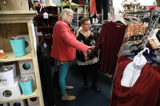 Deborah Dishaw-Smith works with Diane Beaudoin at her boutique,  Deborah Jean & Co., at The Shops on West Ridge in Greece.