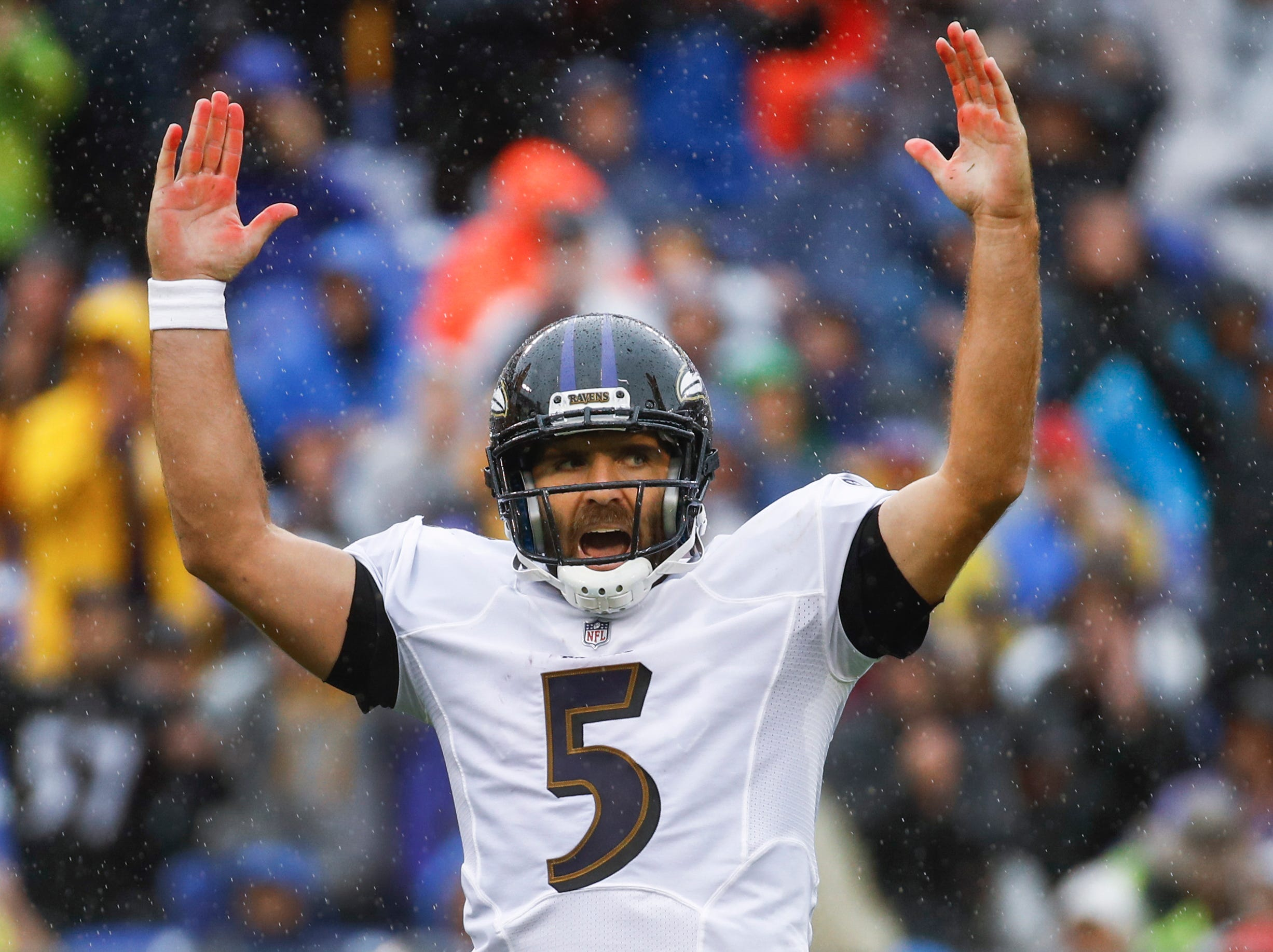 Baltimore Ravens quarterback Joe Flacco (5) celebrates his touchdown pass to wide receiver John Brown during the first half of an NFL football game against the Buffalo Bills, Sunday, Sept. 9, 2018 in Baltimore. (AP Photo/Patrick Semansky)