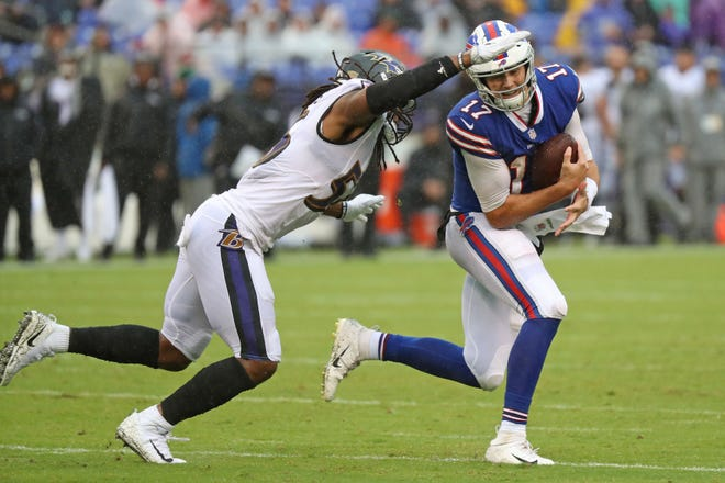 Baltimore Ravens linebacker Tim Williams (56) pressures Buffalo Bills quarterback Josh Allen (17) at M&T Bank Stadium.