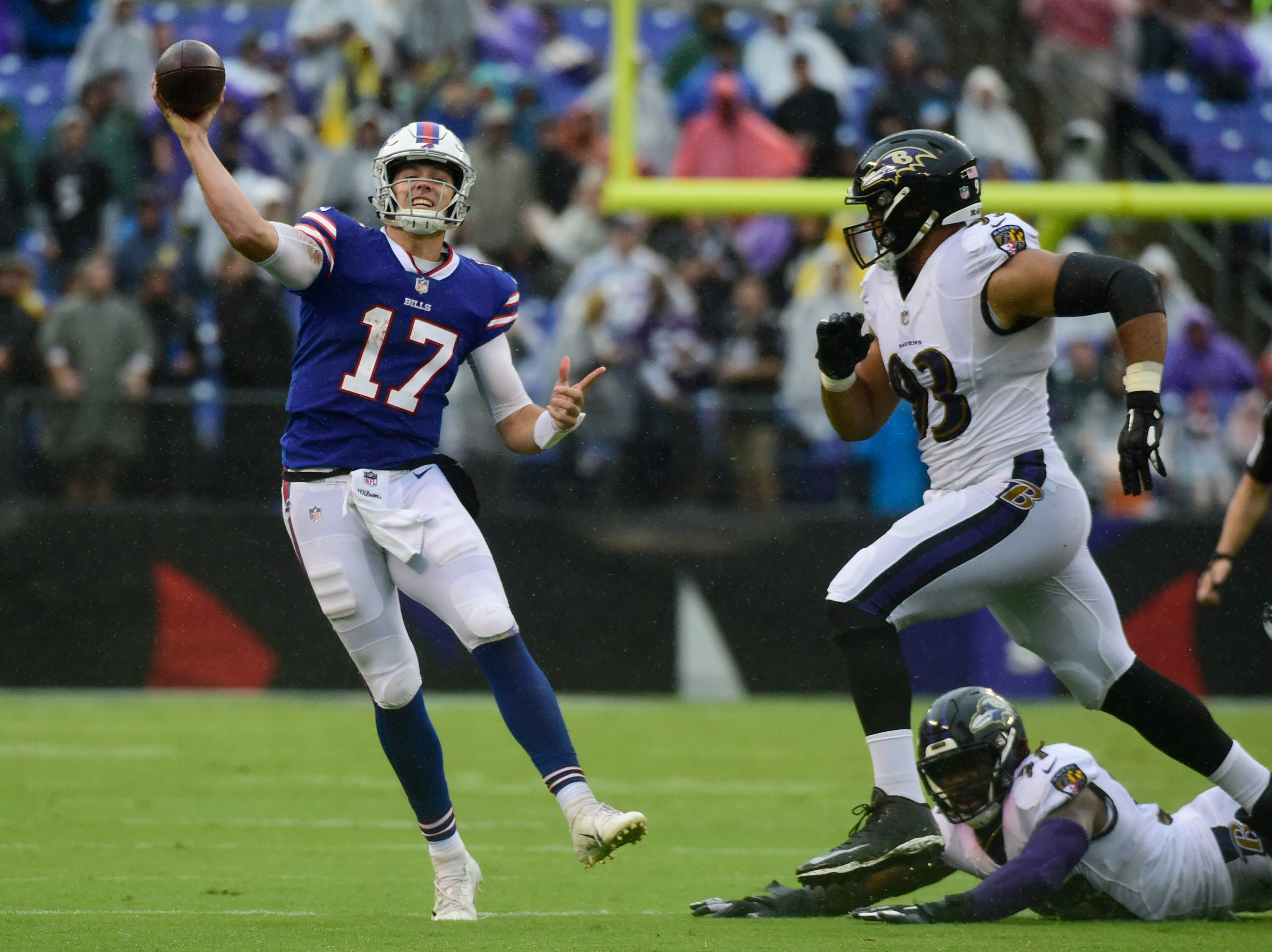 Buffalo Bills quarterback Josh Allen (17) throws on the run as Baltimore Ravens defensive end Chris Wormley (93) applies pressure in the third quarter at M&T Bank Stadium.