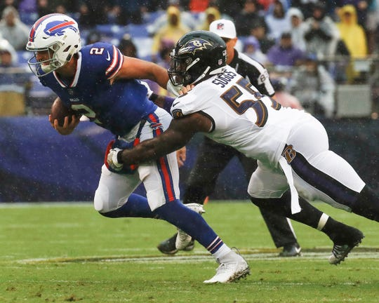 Baltimore Ravens linebacker Terrell Suggs (55) sacks Buffalo Bills quarterback Nathan Peterman (2) during the first half of an NFL football game Sunday, Sept. 9, 2018, in Baltimore.