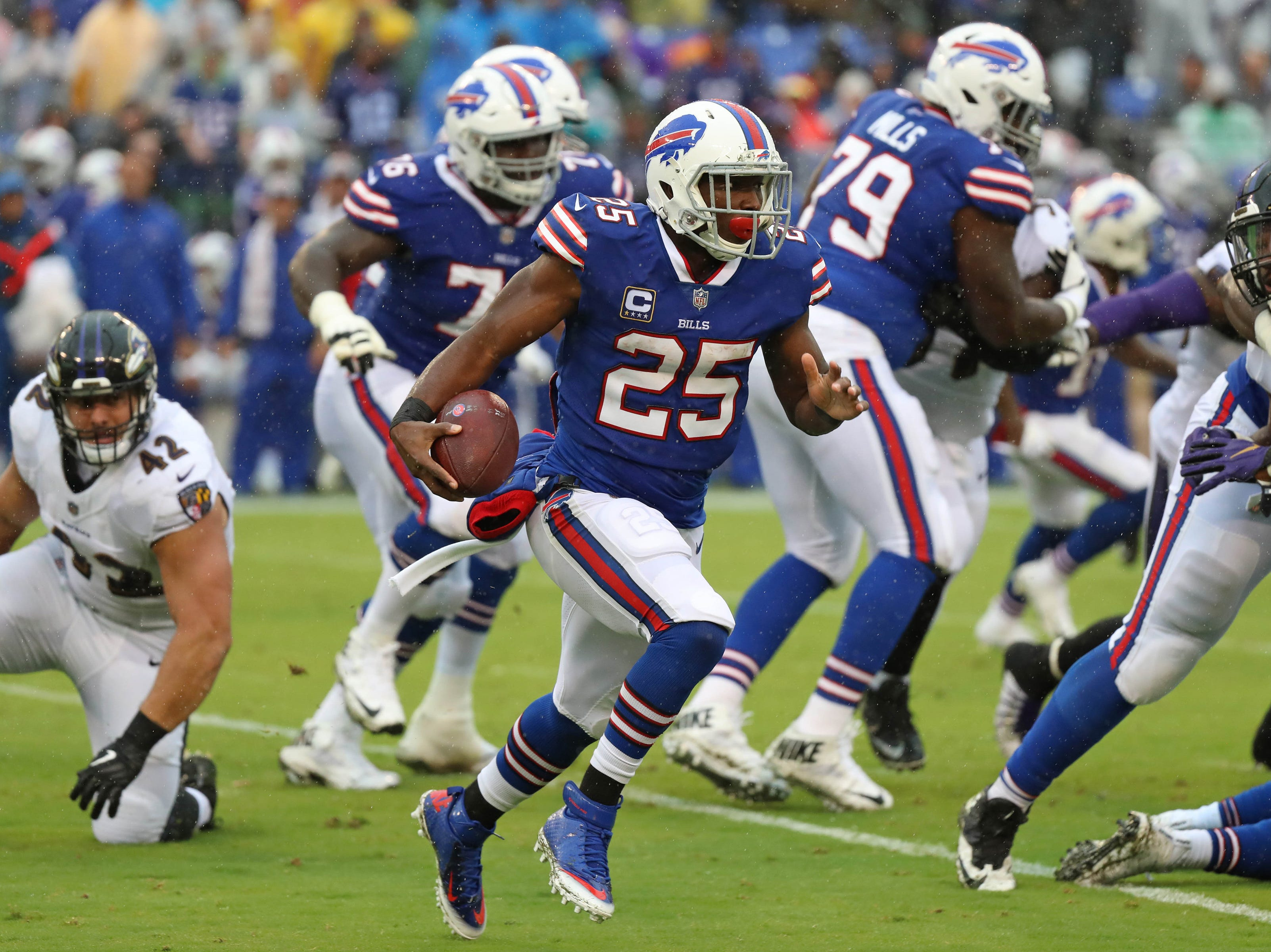 Buffalo Bills running back LeSean McCoy (25) runs for a gain against the Baltimore Ravens at M&T Bank Stadium. Mandatory Credit: Mitch Stringer-USA TODAY Sports