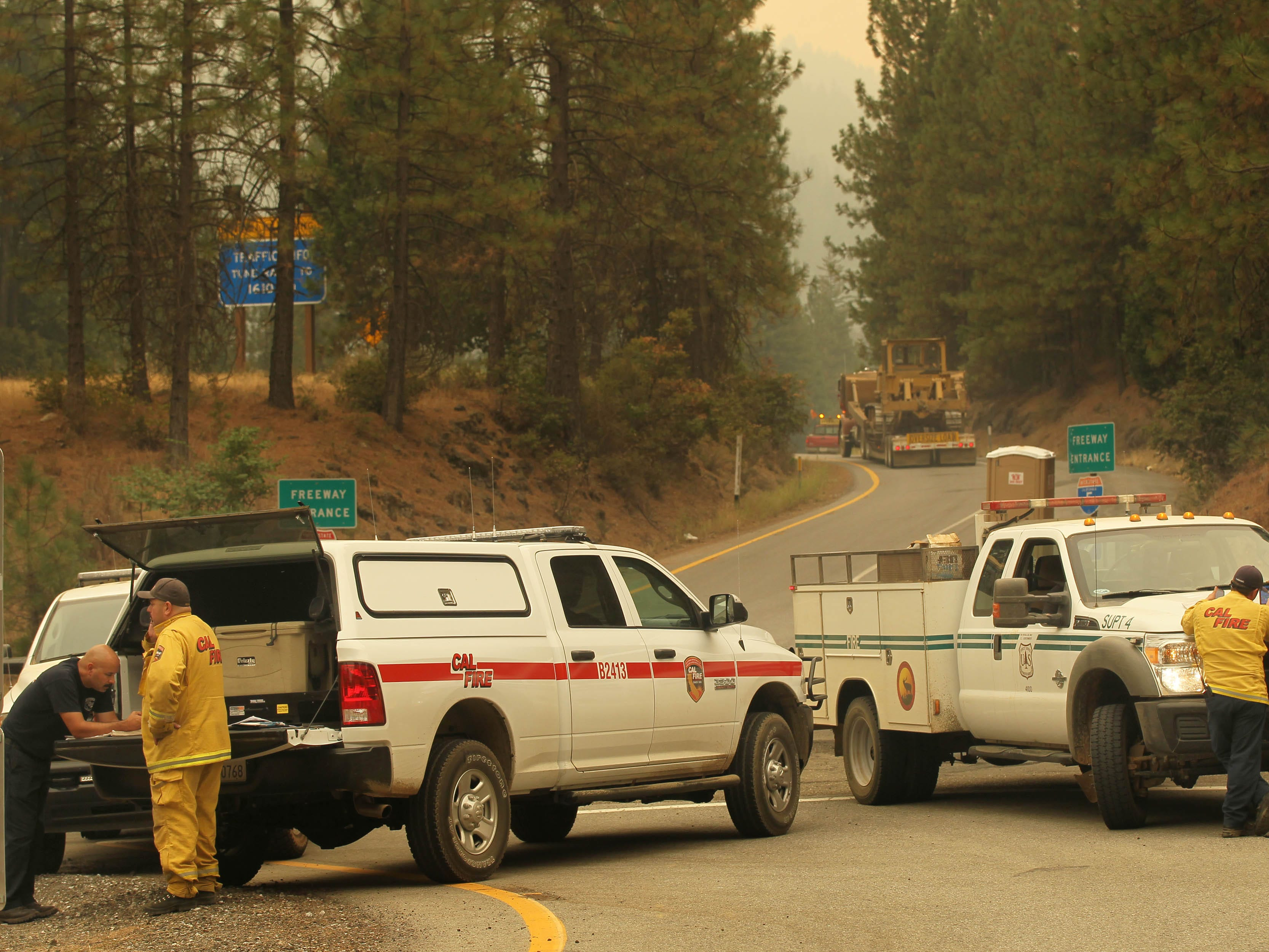 California Department of Forestry and Fire Protection and U.S. Forest Service personnel work together on Saturday afternoon, Sept. 8, 2018 at Sims Road and the Interstate 5 overpass to look into all the resources to plot out where they can put out the fire . (Hung T. Vu/ Special to the Record Searchlight)