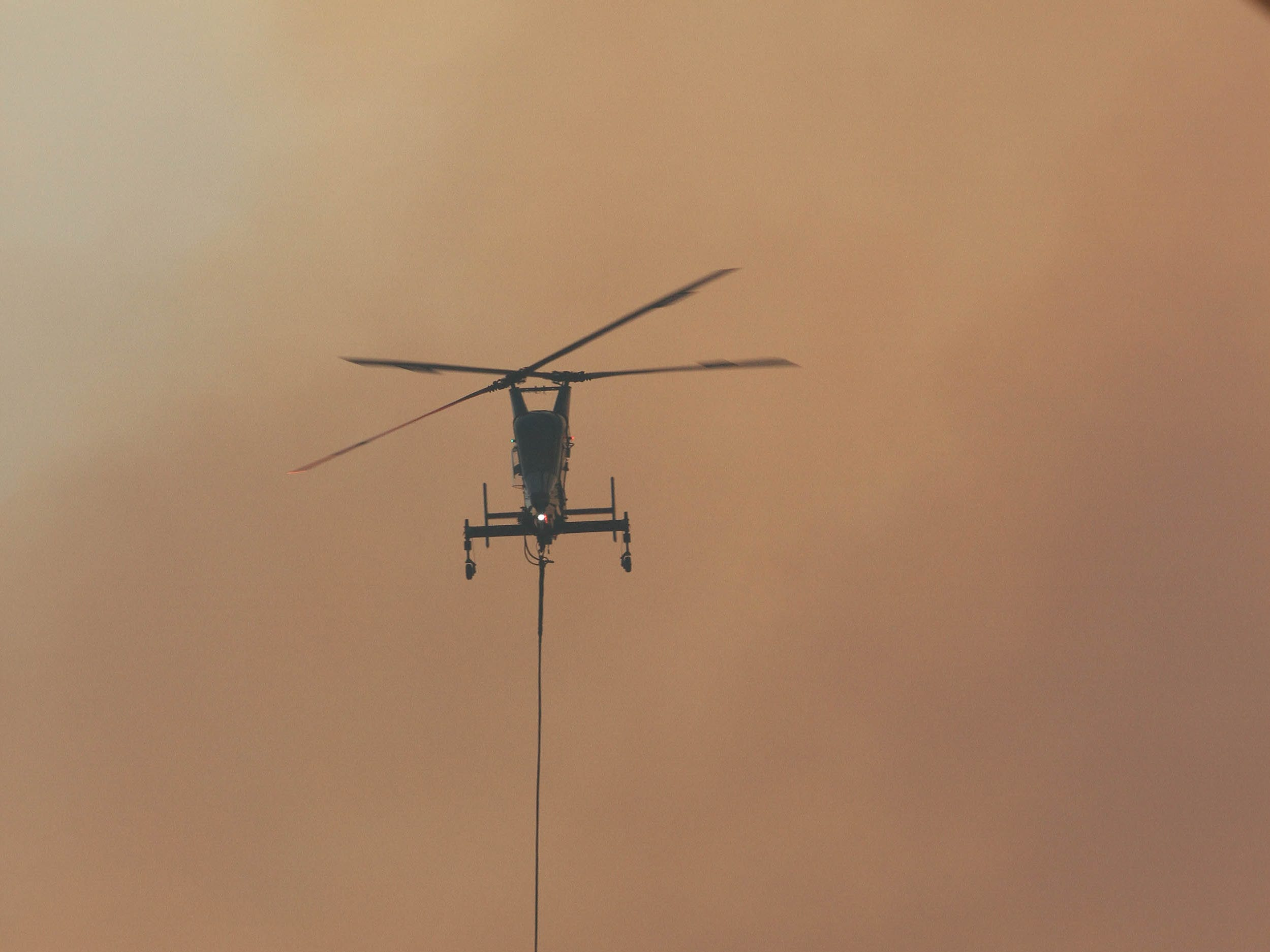 The Delta Fire flared up again Saturday night, Sept. 8, 2018 in the area of Dog Creek Road and Vollmers exit east of Interstate 5. Helicopters circling above dropped water at the top of the ridge line. (Hung T. Vu/ Special to the Record Searchlight)