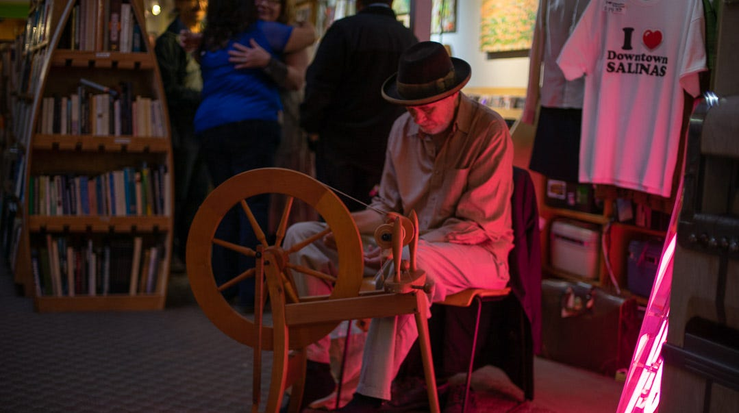 Mark Johnson demonstrating the spinning wheel yarn at Salinas 411 during the 13th anniversary of 1st Fridays in Downtown Salinas.