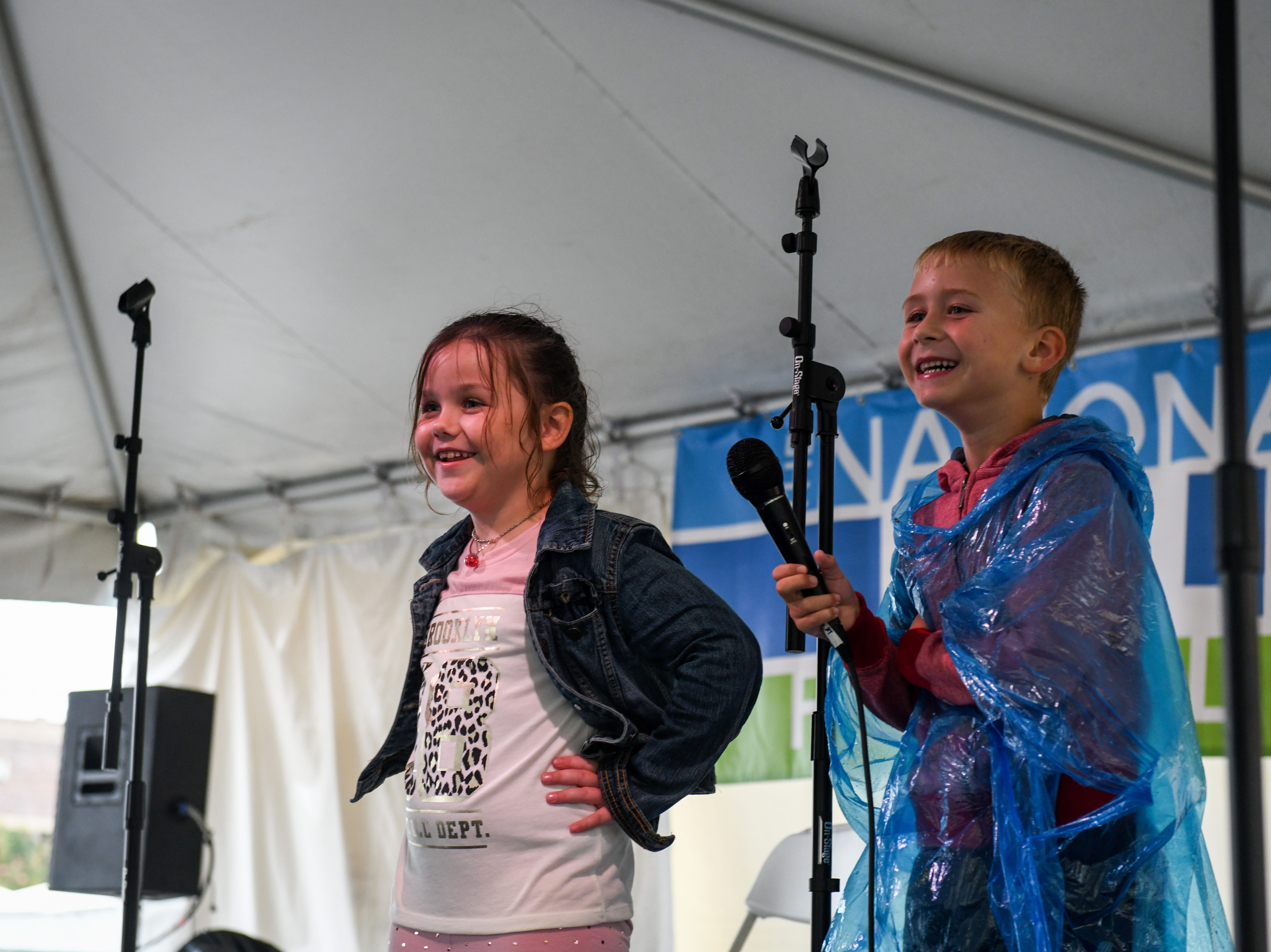 Ruby Ludwick (left) and Reice Manning learn to beatbox with performer Shodekeh at the National Folk Fest in Salisbury on Sunday, Sept. 9.