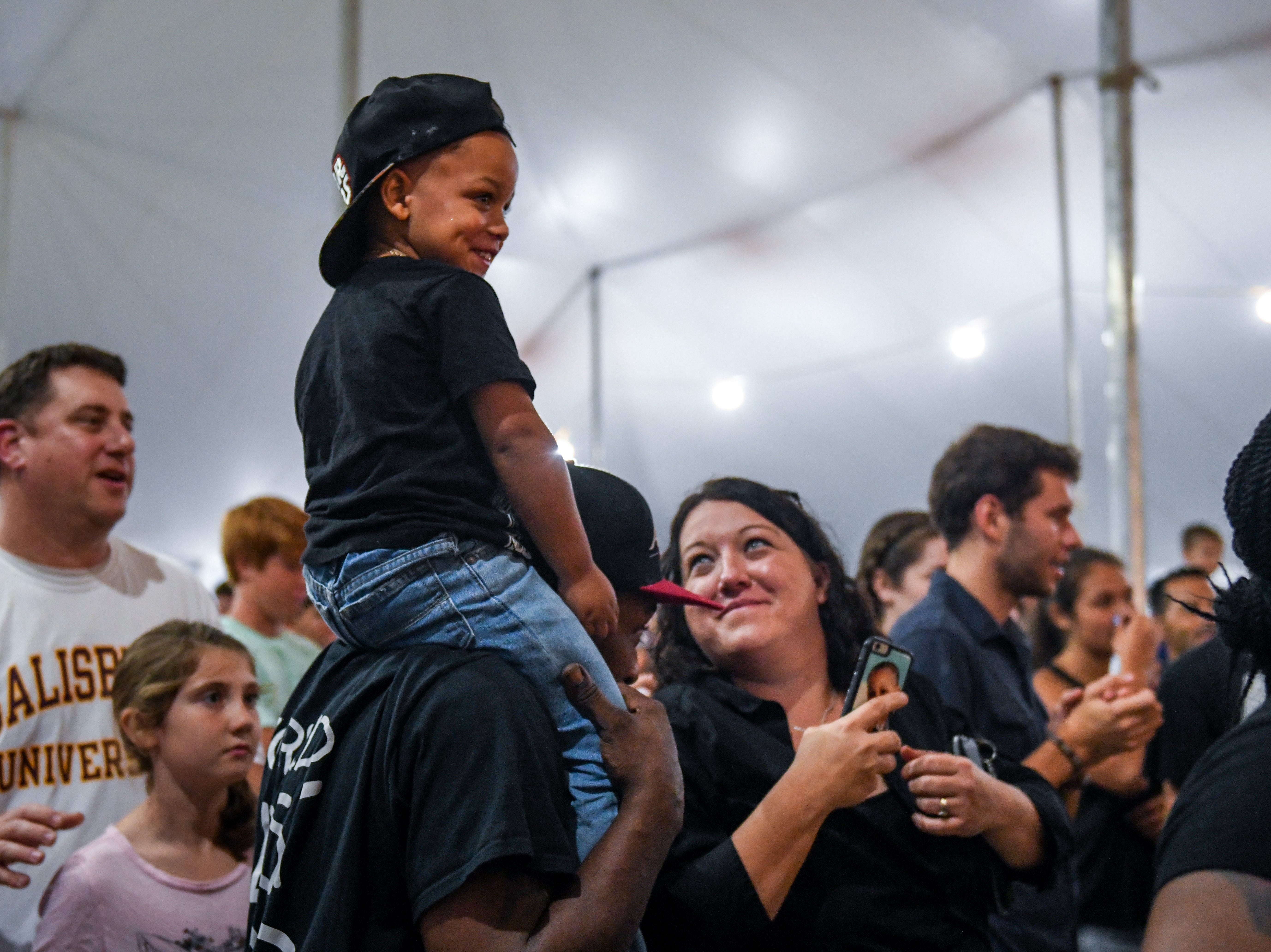 Jude Matthews gets a better view atop his father James Matthew's shoulders at Rahzel's performance at the National Folk Festival in Salisbury on Saturday, Sept. 8.