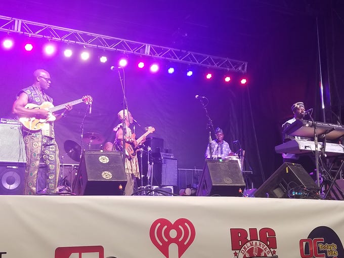 The West African Highlife Band performs on the City Stage on Saturday night at the National Folk Festival.