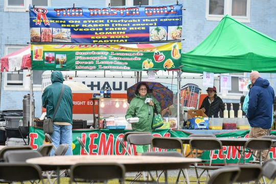 Festival attendees braved the rain at the National Folk Fest in Salisbury on Sunday, Sept. 9.