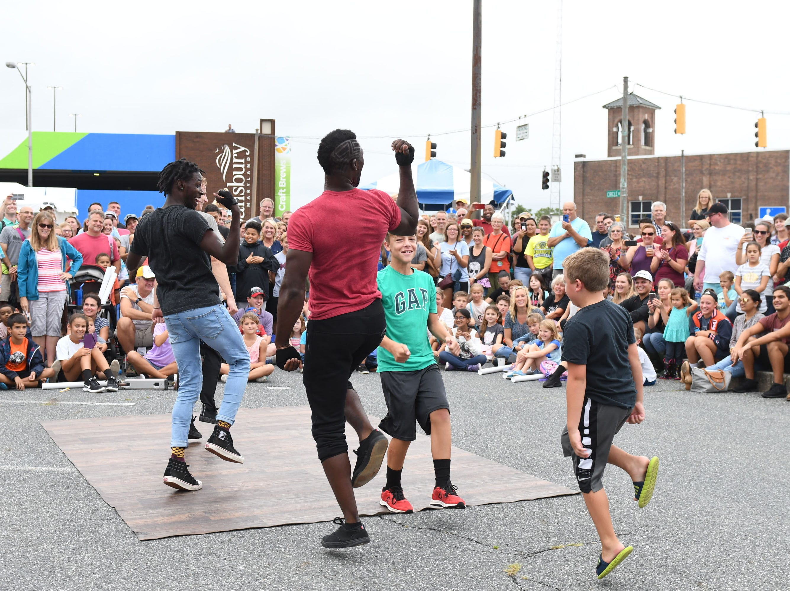The Dancing on Air Crew got the crowd into the action during the 78th National Folk Festival on Saturday, Sept. 8, 2018.