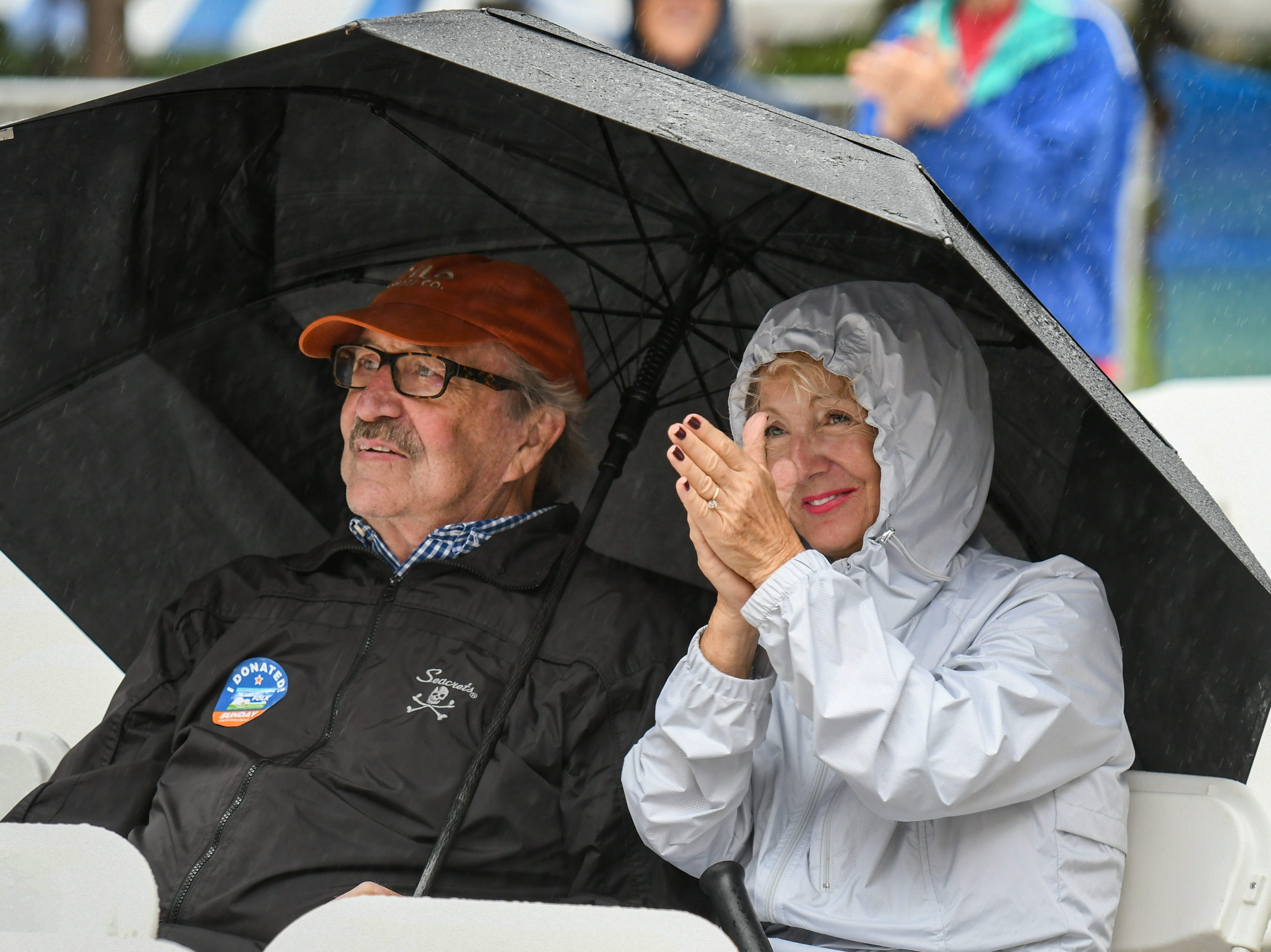 Attendees cheer for Mangum & Company from the rain at the National Folk Fest in Salisbury on Sunday, Sept. 9.
