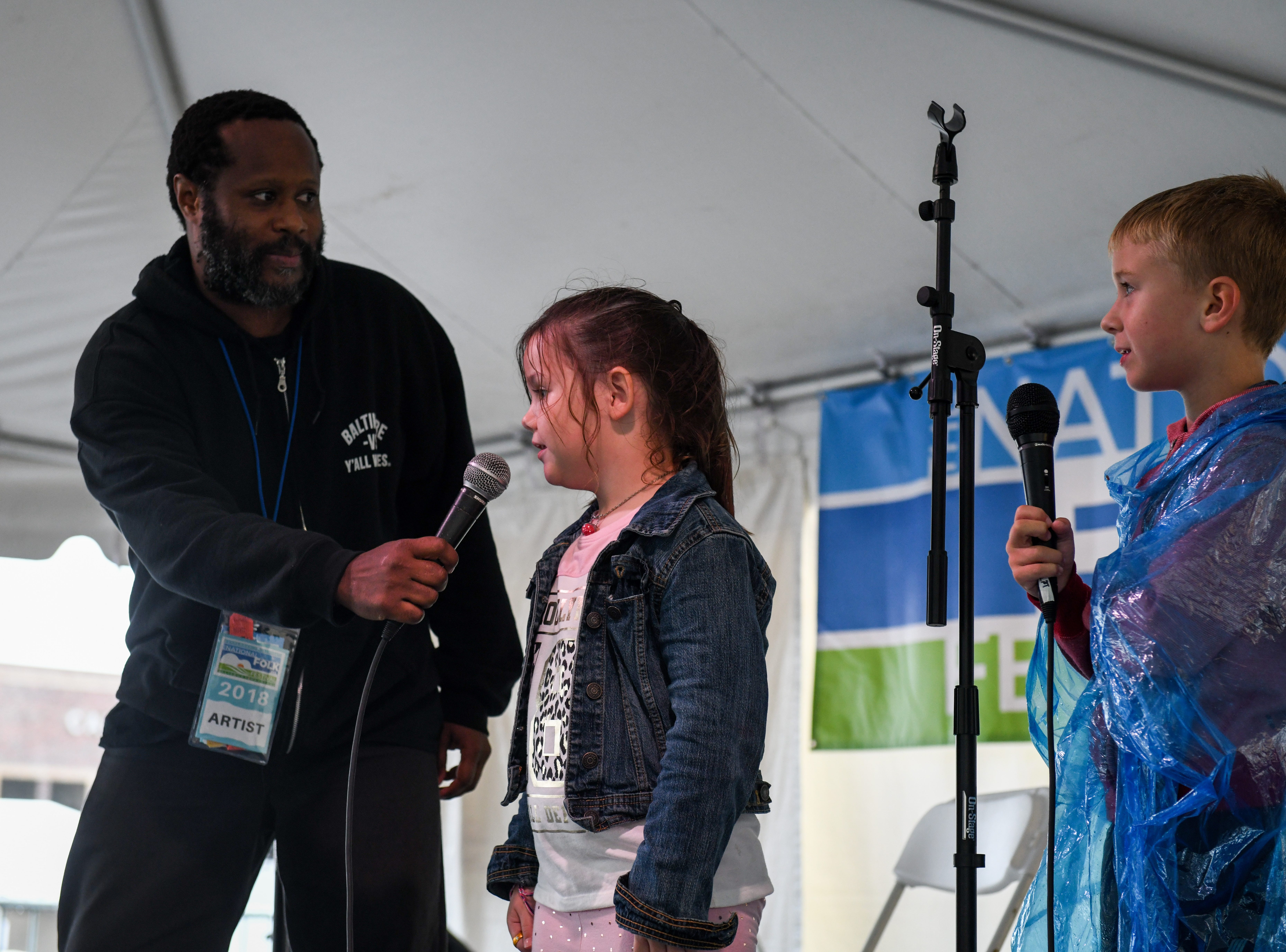 7-year-old Ruby Ludwick learns to beatbox with performer Shodekeh at the National Folk Fest in Salisbury on Sunday, Sept. 9.