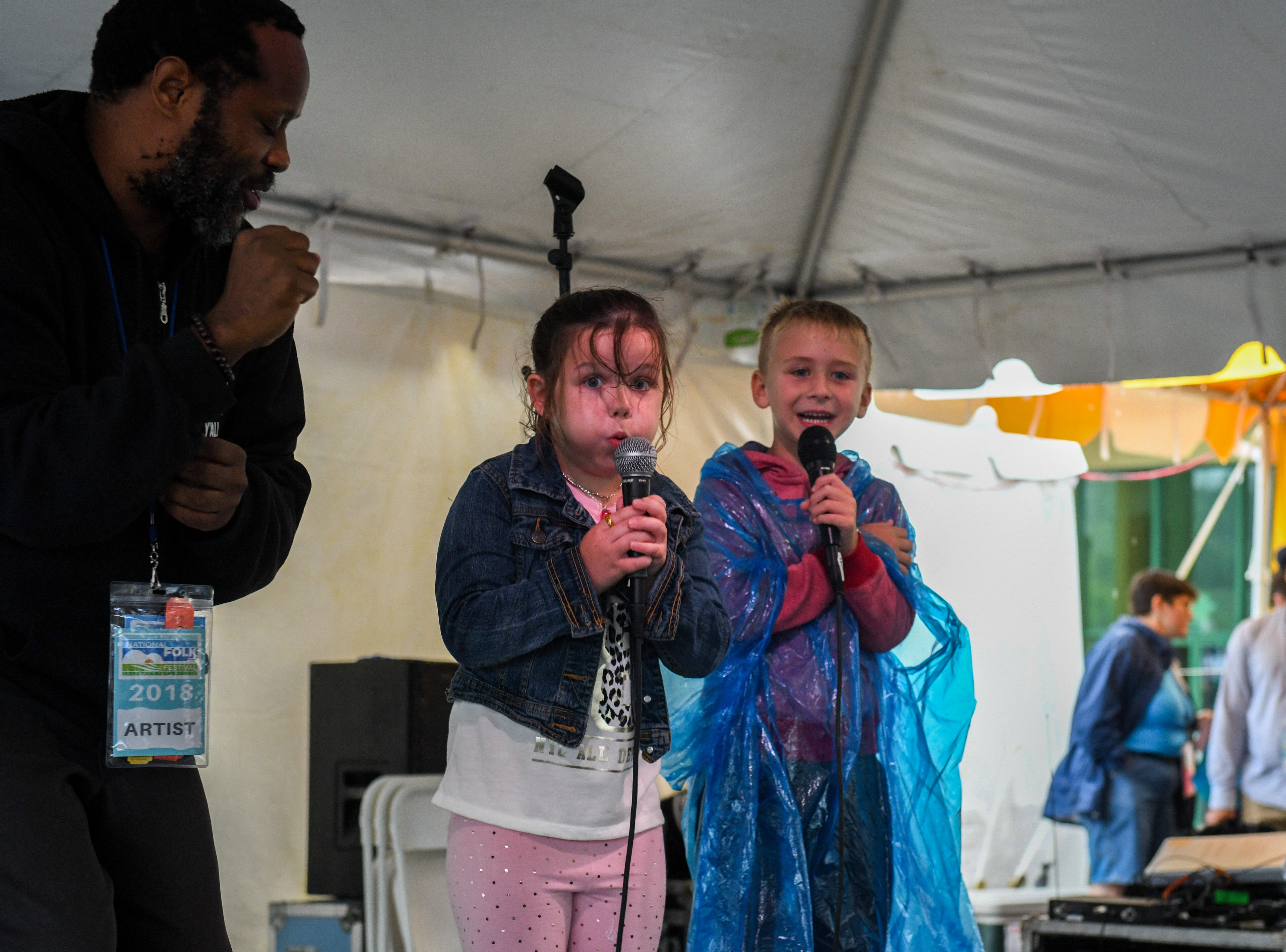 7-year-old Ruby Ludwick learns some beatboxing sounds from Shodekeh at the National Folk Festival in Salisbury on Sunday, Sept. 9.