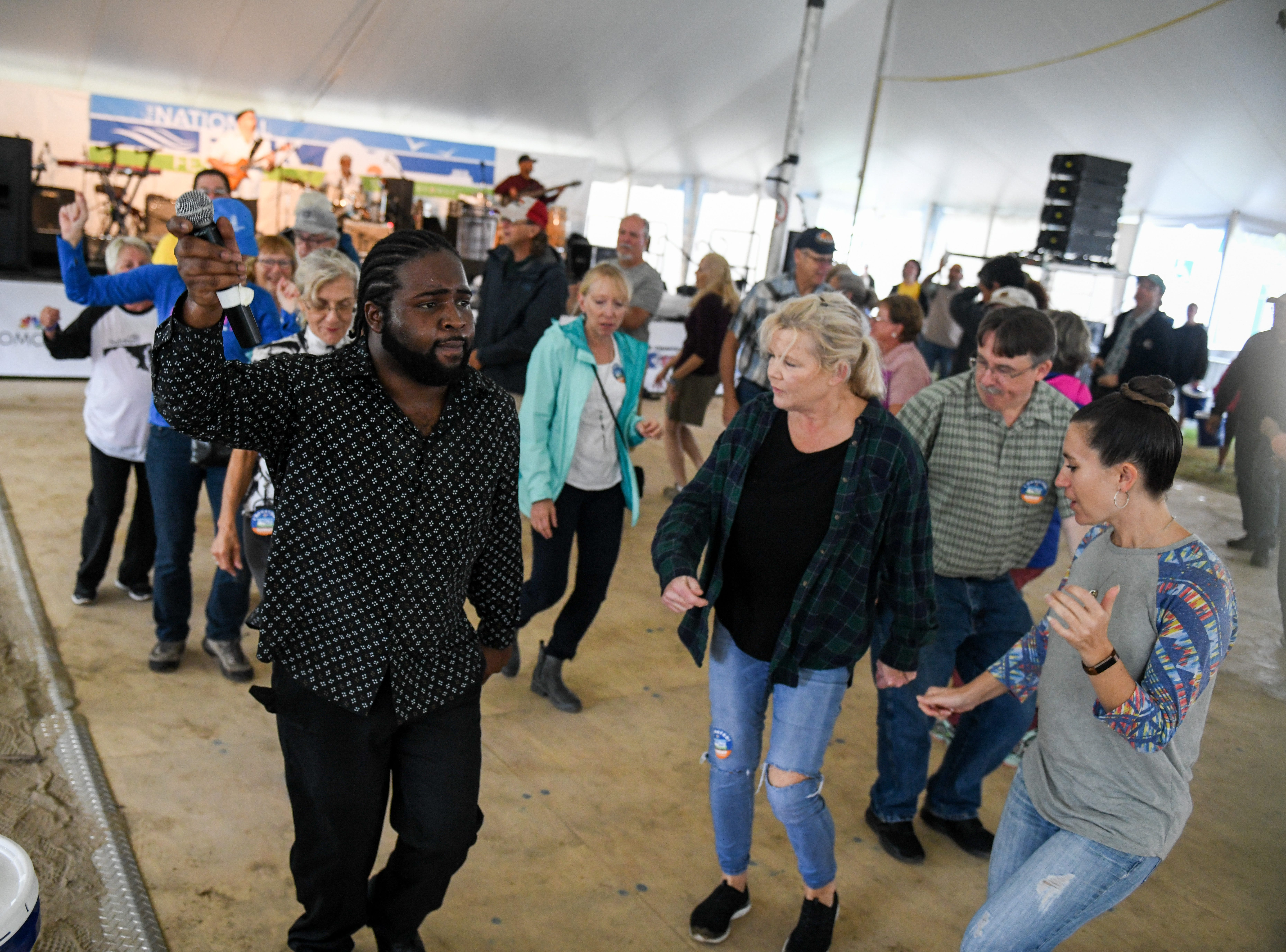 Festival attendees dance and cheer at the Marquise Knox performance at the National Folk Fest in Salisbury on Sunday, Sept. 9.