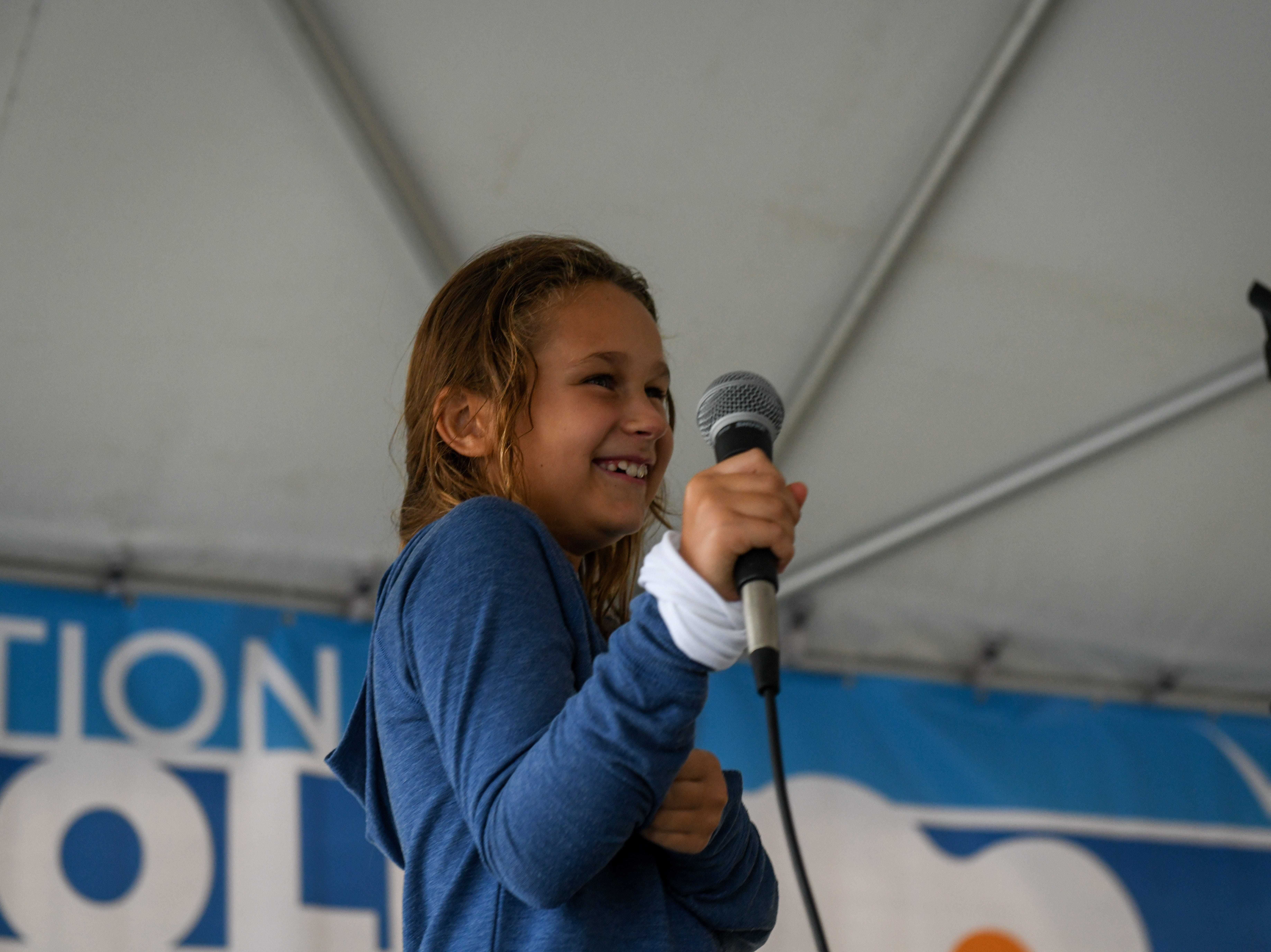 8-year-old Gracie Seman learns to beatbox with performer Shodekeh at the National Folk Fest in Salisbury on Sunday, Sept. 9.