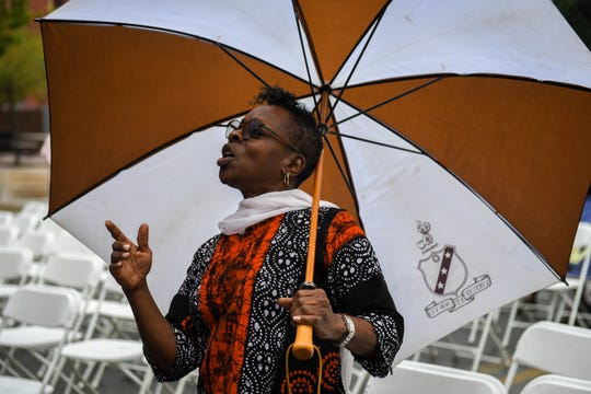 Theda Zawaiza enjoys the music of Mangum & Company at the National Folk Festival in Salisbury on Sunday, Sept. 9.