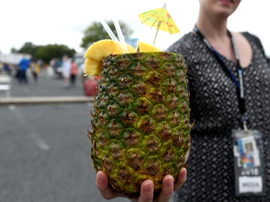 Huge Pinapple Smoothies being offered at the 78th National Folk Festival on Saturday, Sept. 8, 2018.