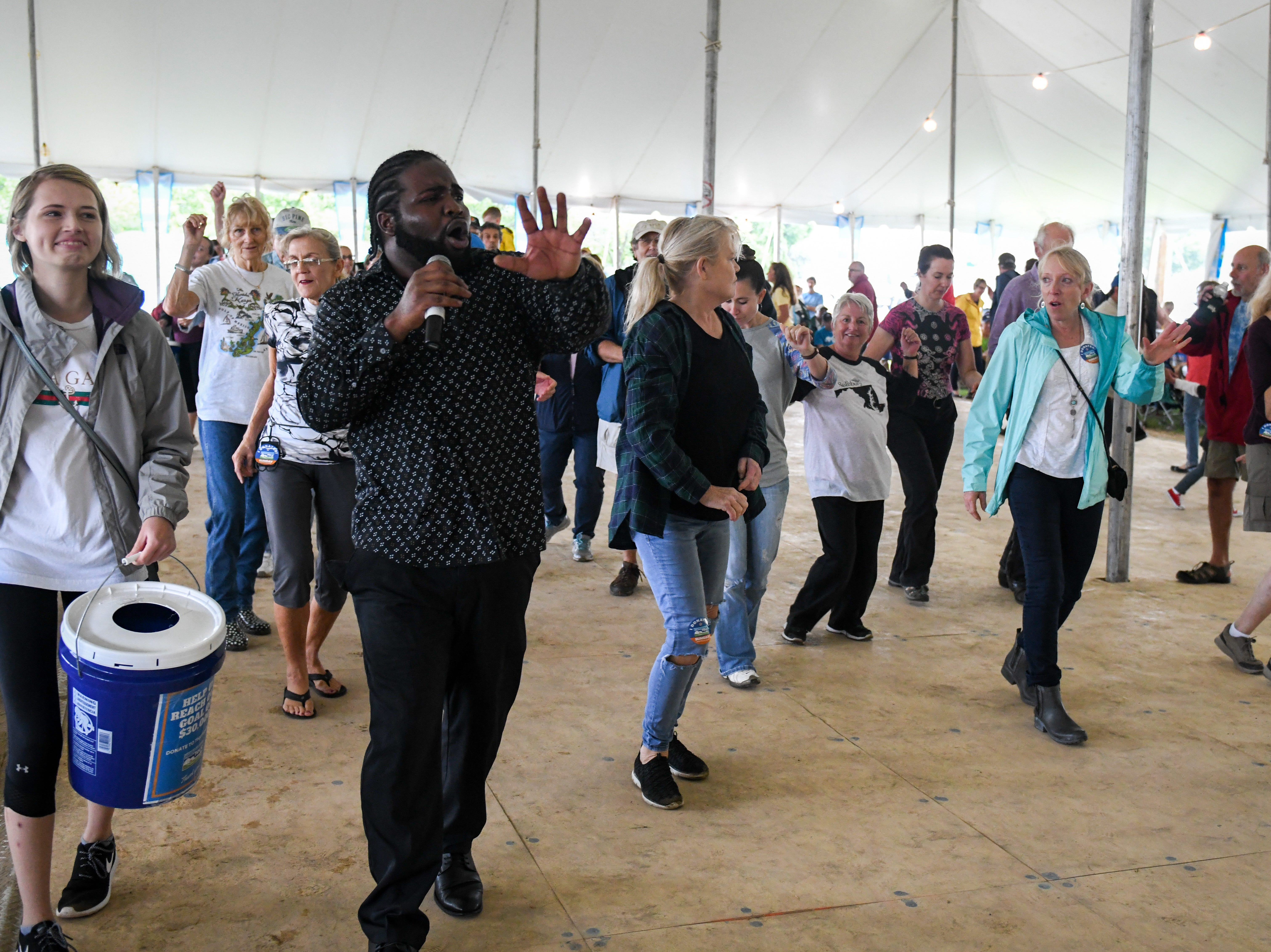 Marquise Knox performs a blues show to an excited crowd at the National Folk Festival in Salisbury on Sunday, Sept. 9.