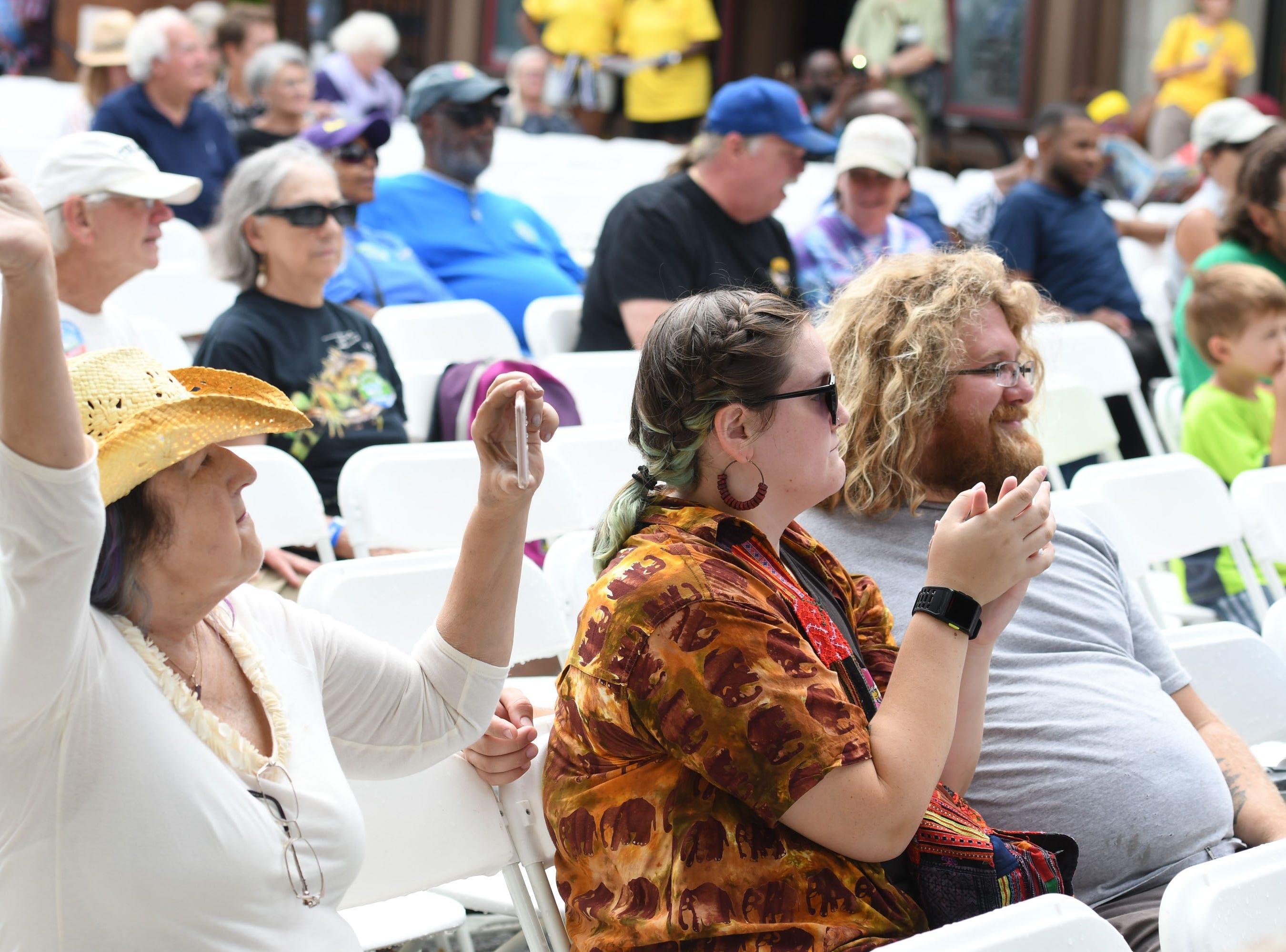 National Folk Festival attendees listen to Make a Joyful Noise: Gospel Masters on Saturday, Sept. 8, 2018 in Salisbury, Md.