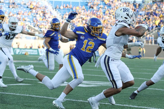 South Dakota State's Logan Backhaus (12) brings Montana State's Maleek Barkley down for a loss during the first quarter of the Jackrabbits' matchup against the Bobcats Saturday night at Dana J. Dykhouse Stadium in Brookings. Jason Salzman For The Argus Leader