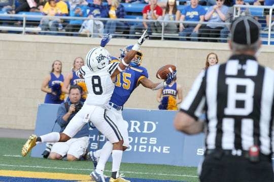South Dakota State's Cade Johnson (15) makes an incredible one-handed grab for a touchdown in front of Montana State's Jalen Cole during the second quarter of the Jackrabbits' matchup against the Bobcats Saturday night at Dana J. Dykhouse Stadium in Brookings. Jason Salzman For The Argus Leader